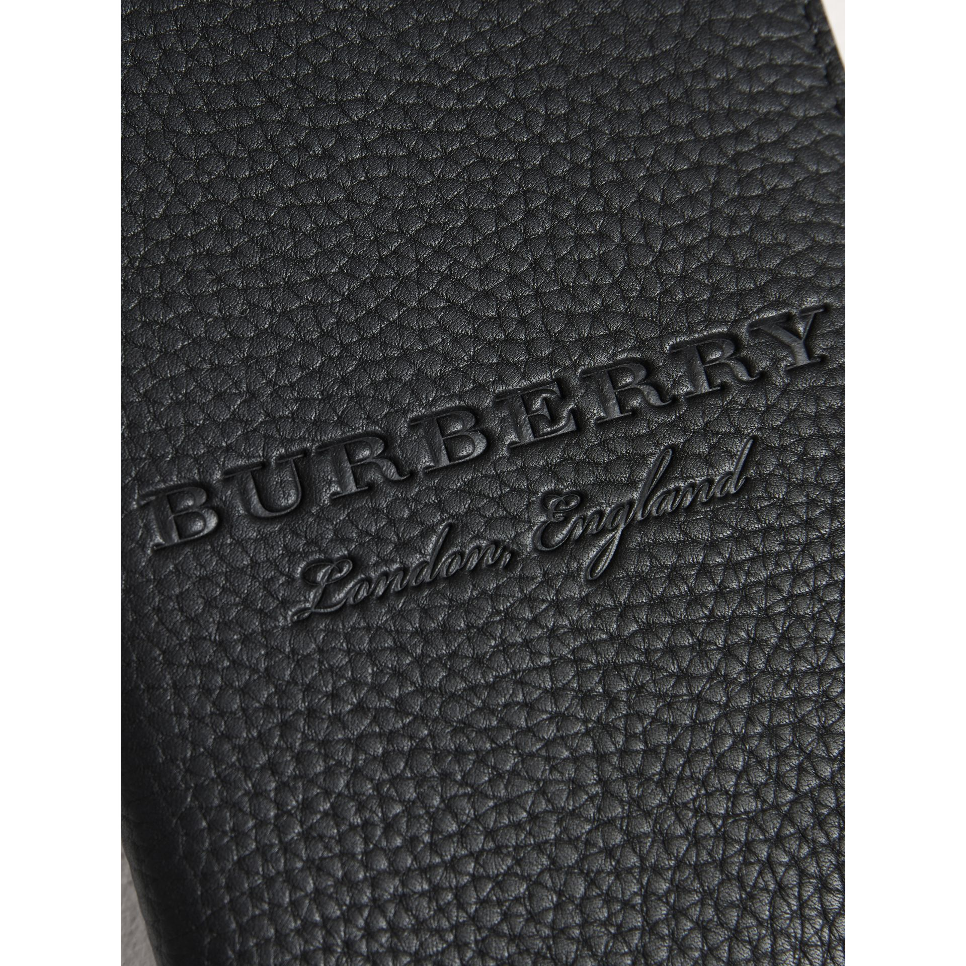 Embossed Leather Passport Holder in Black | Burberry - gallery image 1