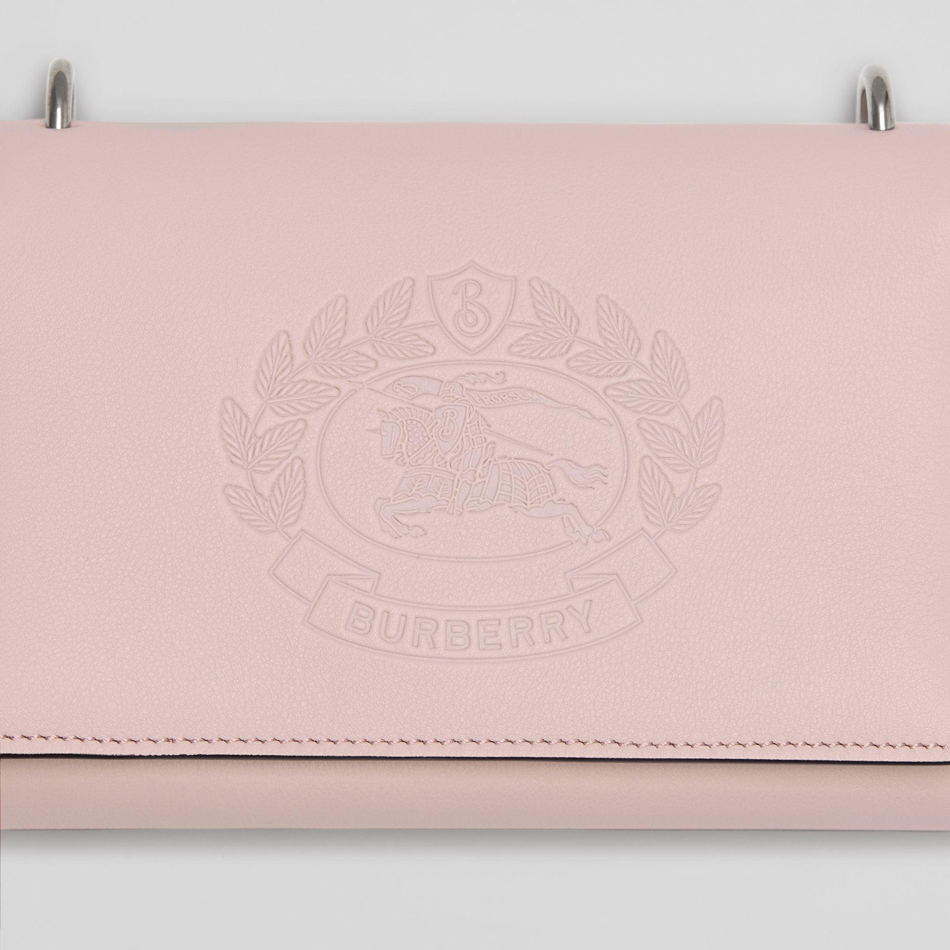 Embossed Crest Leather Wallet with Detachable Strap in Chalk Pink - Women | Burberry - gallery image 1