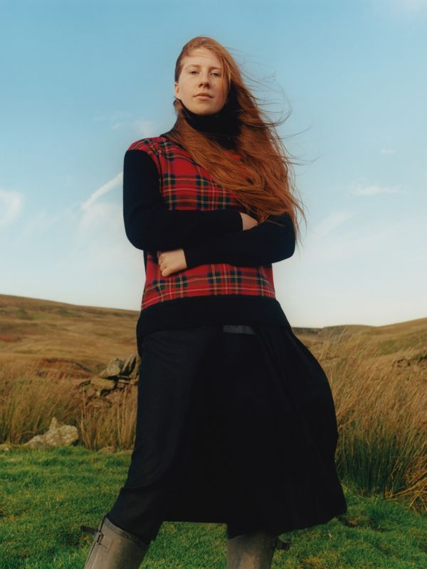 Raven Owen, farmer. Photographed in the Yorkshire Dales, wearing tartan panel wool cashmere.