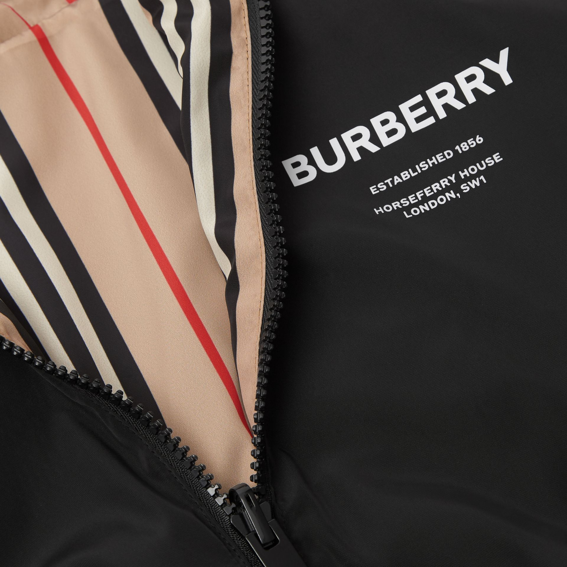 Reversible Icon Stripe Hooded Jacket in Black | Burberry Canada - gallery image 1