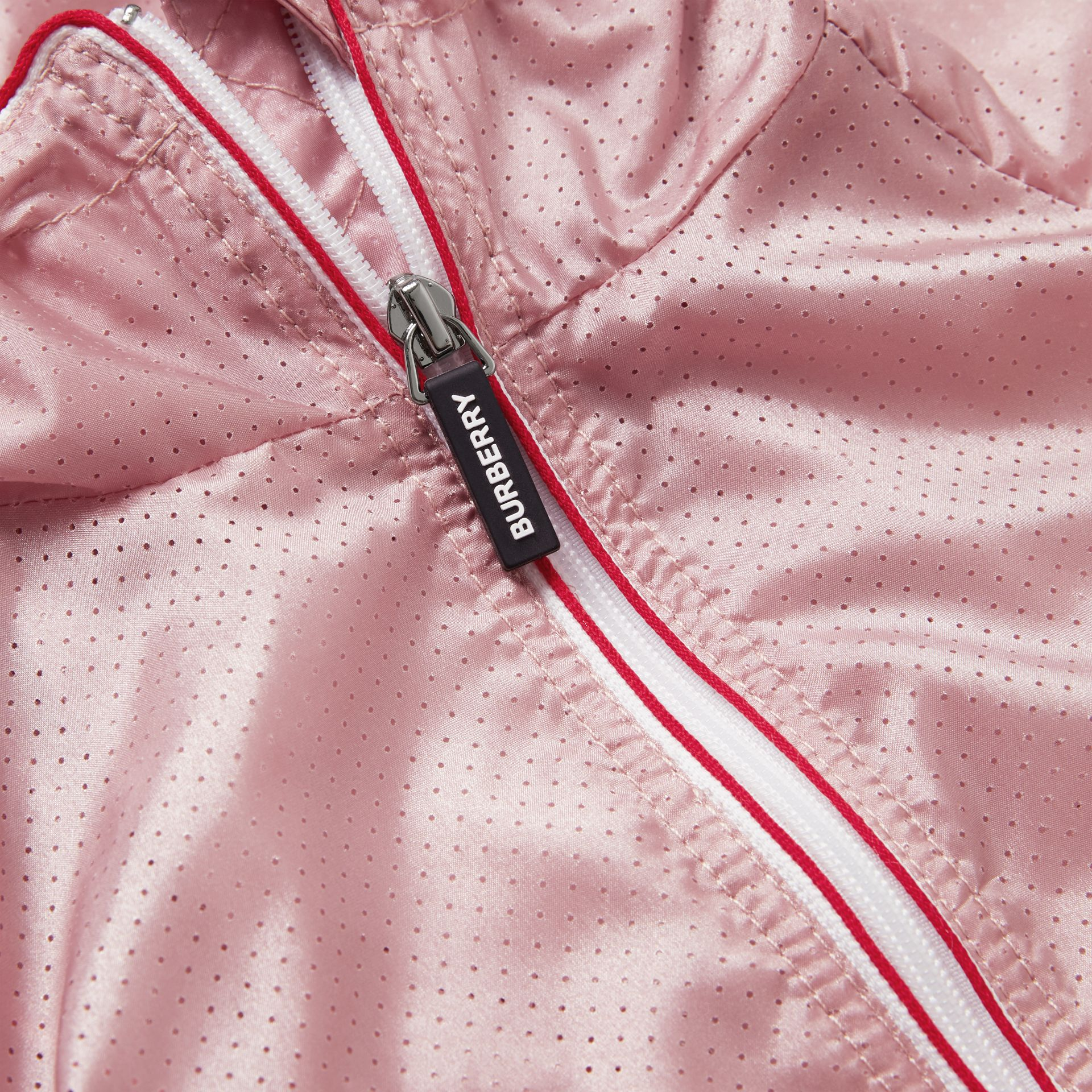 Logo Print Perforated Hooded Jacket in Pearl Rose | Burberry - gallery image 1