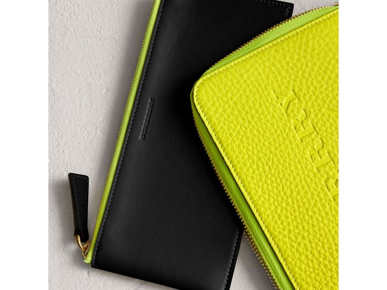 Embossed Neon Leather Travel Wallet in Bright Yellow | Burberry United Kingdom - cell image 1