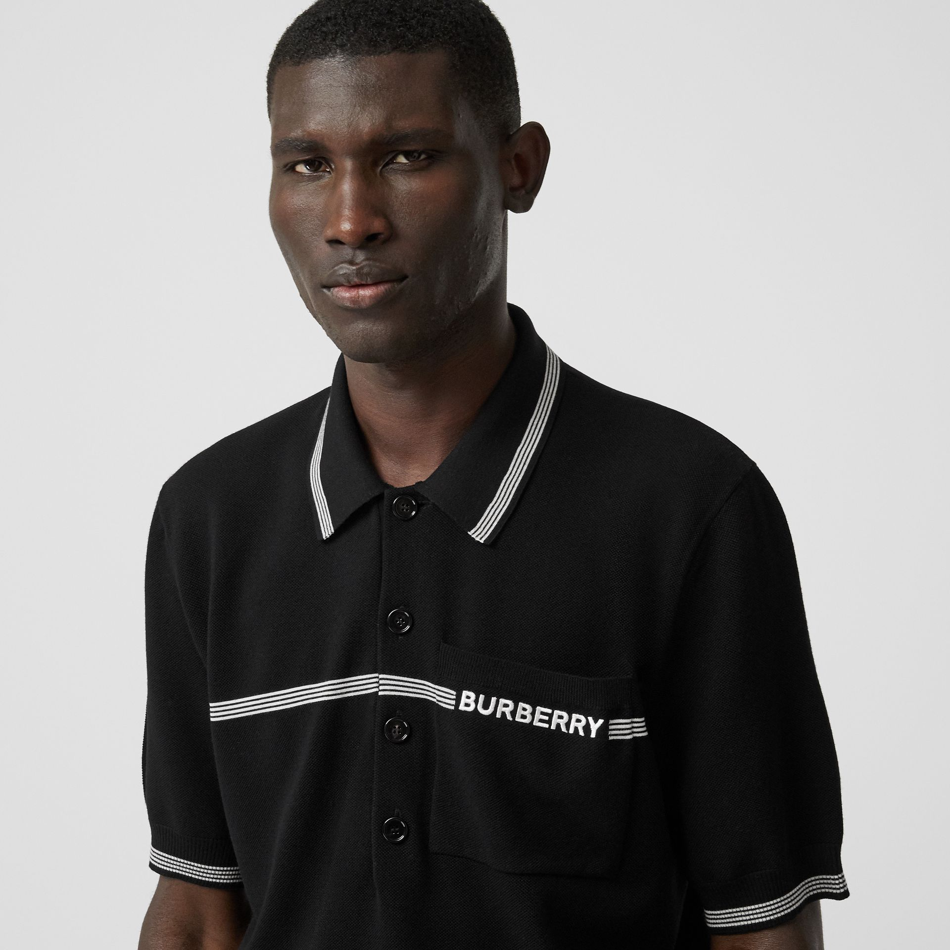Logo Embroidered Wool Polo Shirt in Black | Burberry - gallery image 1