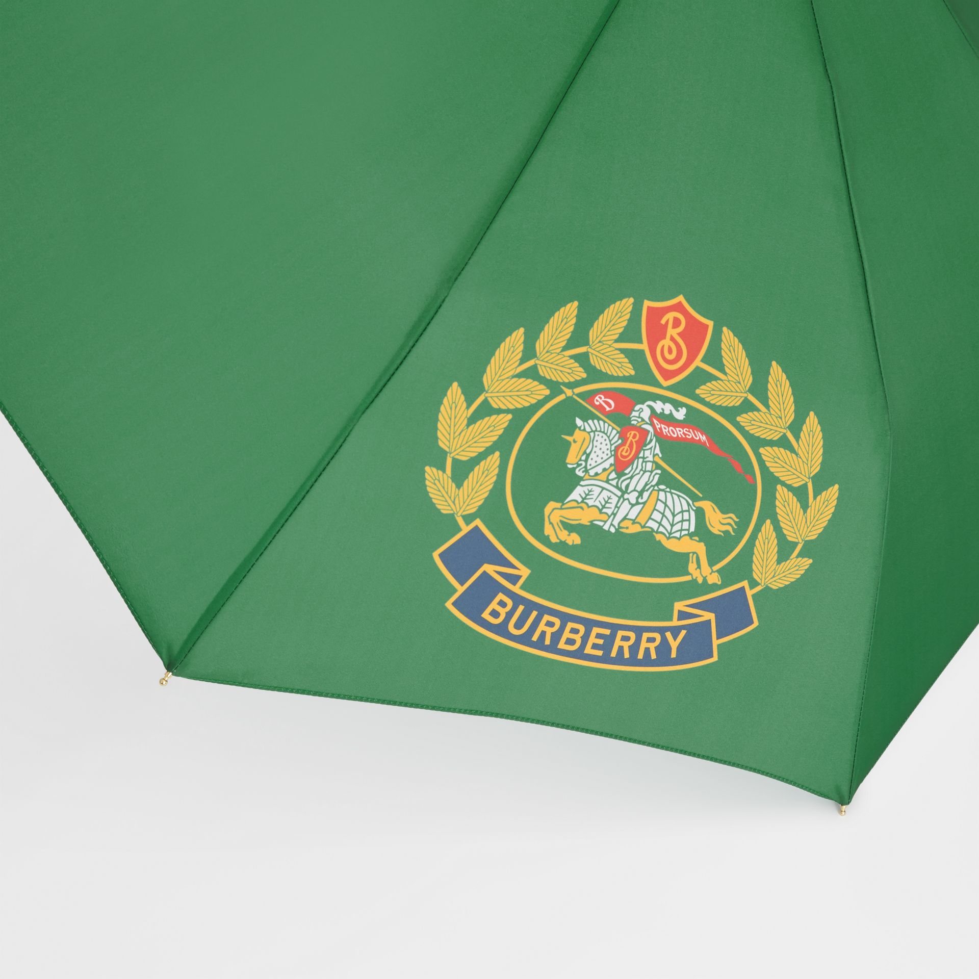 Crest Print Folding Umbrella in Dark Forest Green | Burberry United Kingdom - gallery image 1