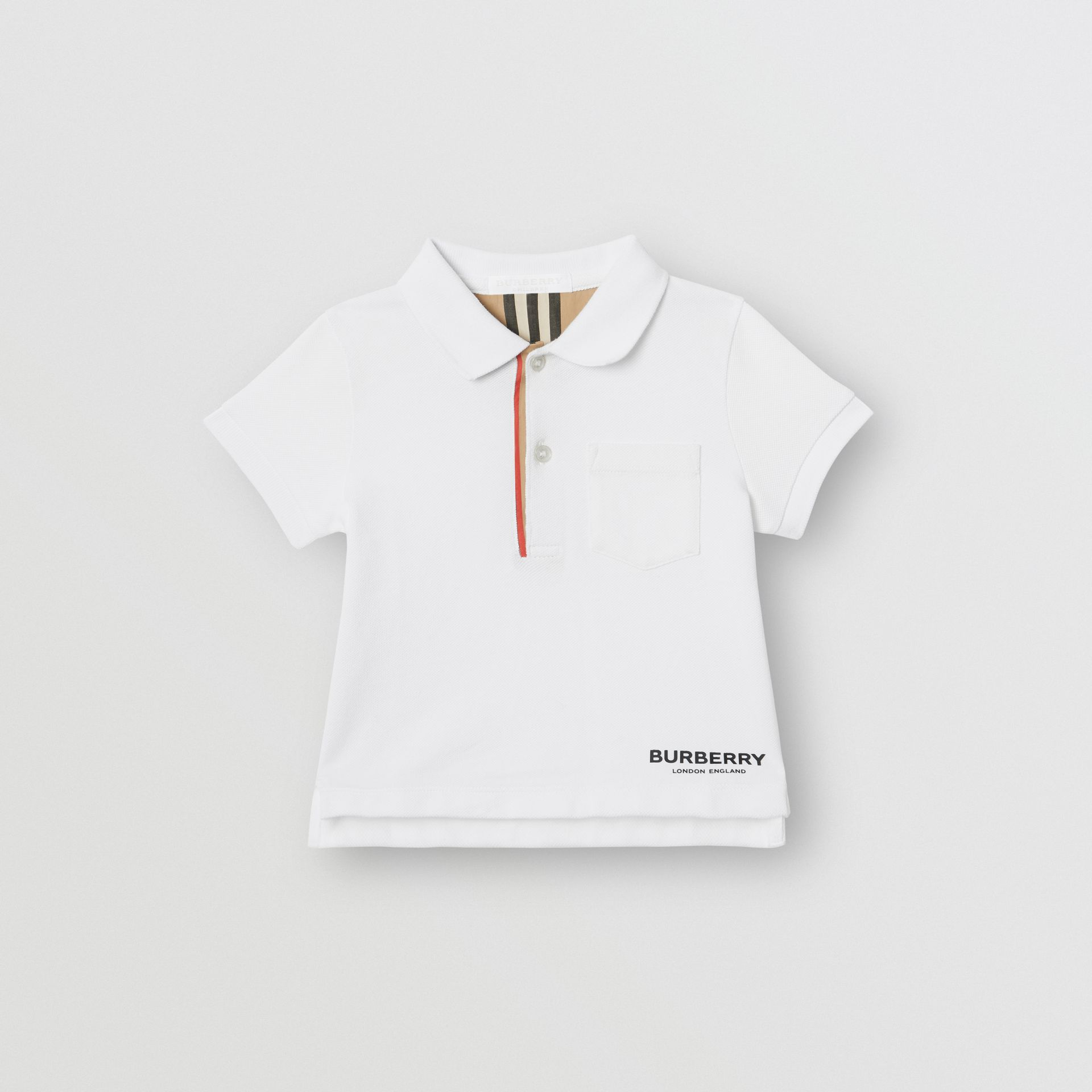 Icon Stripe Placket Cotton Piqué Polo Shirt in White - Children | Burberry - gallery image 0