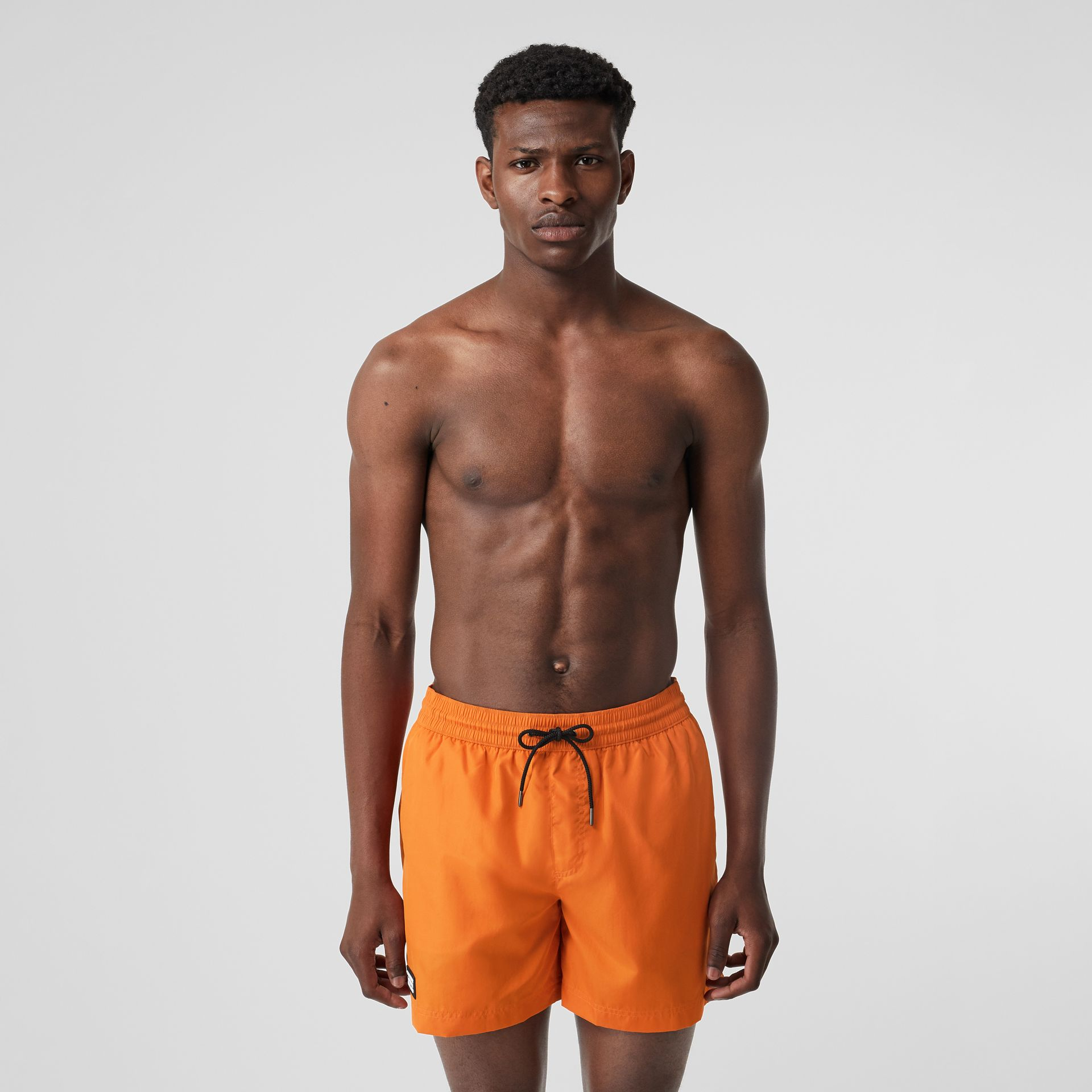 Logo Detail Drawcord Swim Shorts in Bright Orange - Men | Burberry Canada - gallery image 0