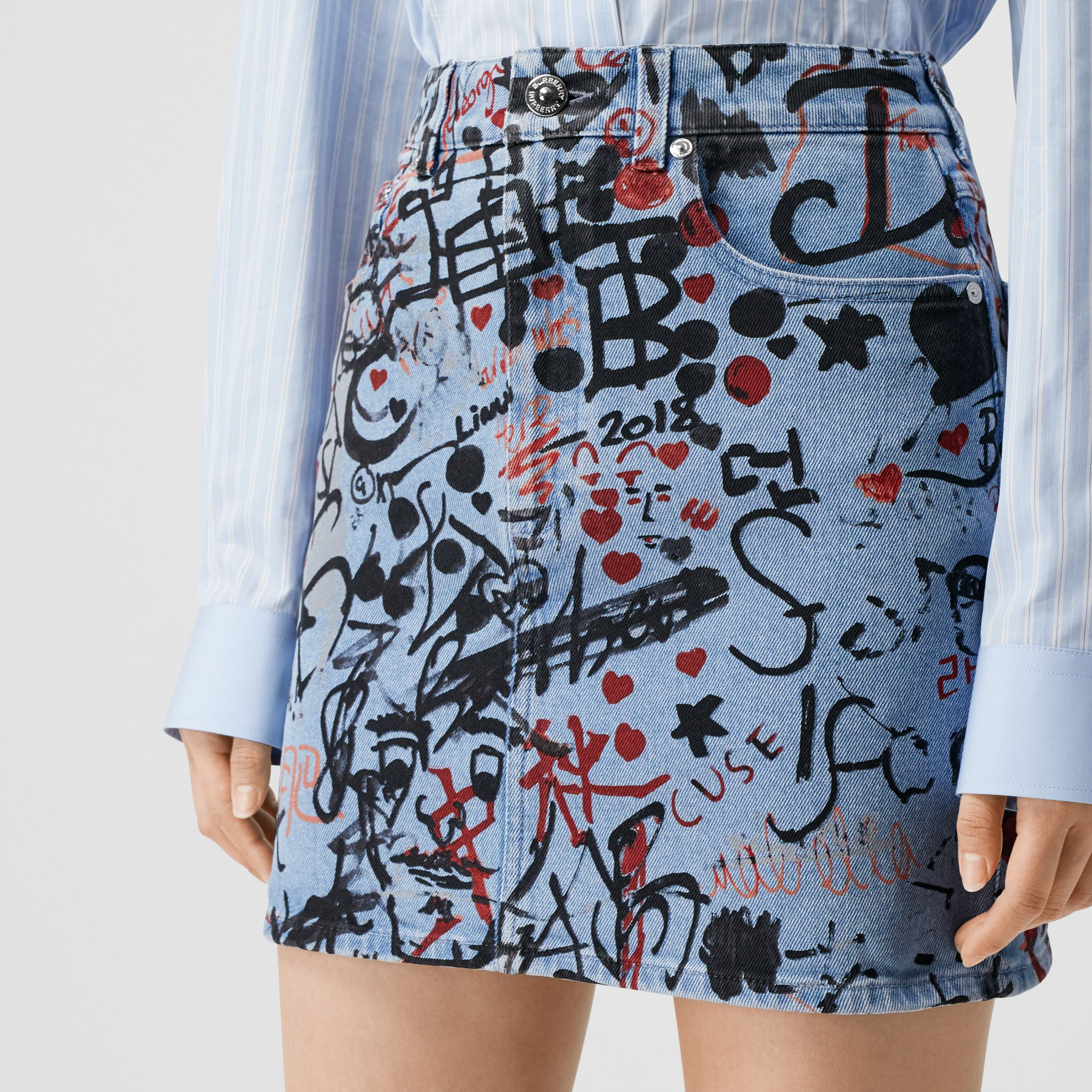 Graffiti Print Washed Denim Mini Skirt in Light Indigo - Women | Burberry Australia - 2