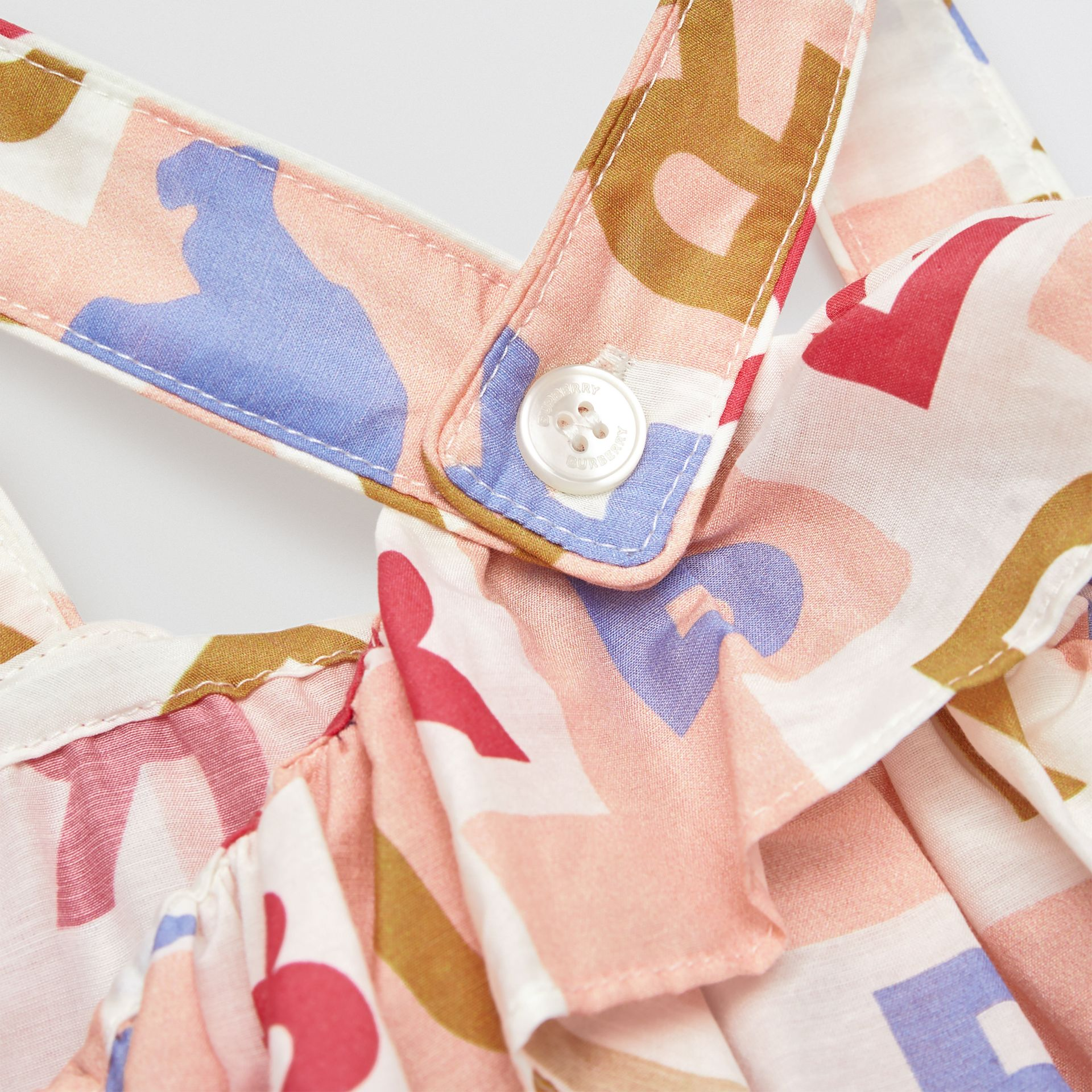 Ruffle Detail Logo Print Cotton Silk Playsuit in Pale Rose - Children | Burberry - gallery image 1