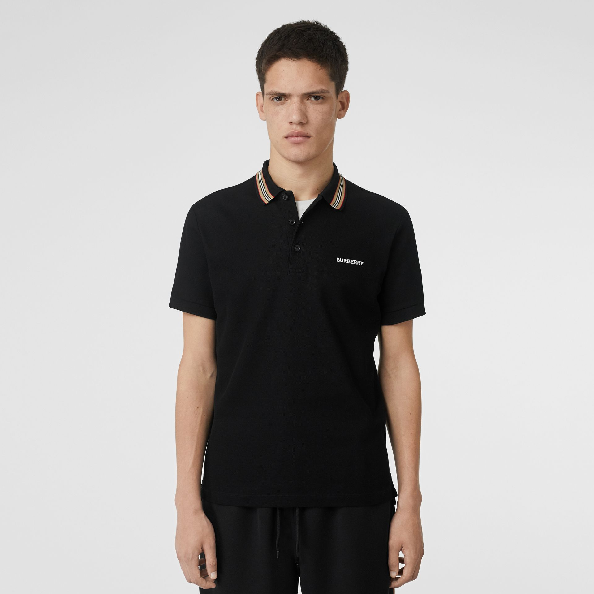 Icon Stripe Detail Cotton Piqué Polo Shirt in Black - Men | Burberry Canada - gallery image 0