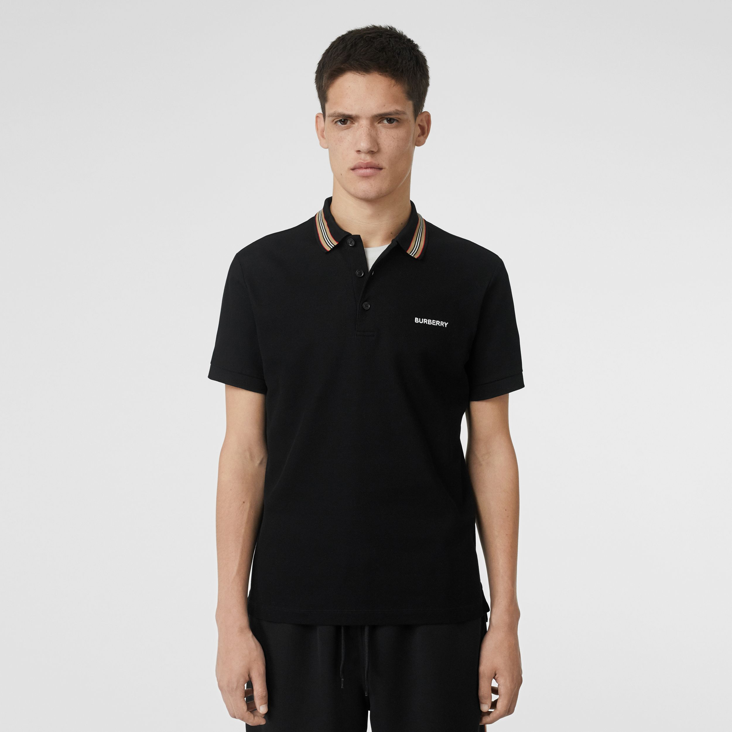 Icon Stripe Detail Cotton Piqué Polo Shirt in Black - Men | Burberry - 1