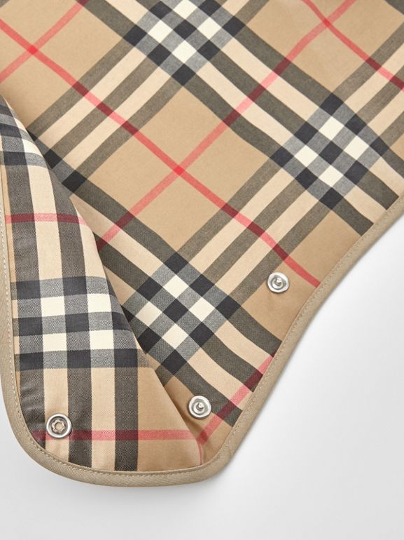 Coated Vintage Check and Icon Stripe Bib in Archive Beige - Children | Burberry United Kingdom - cell image 1