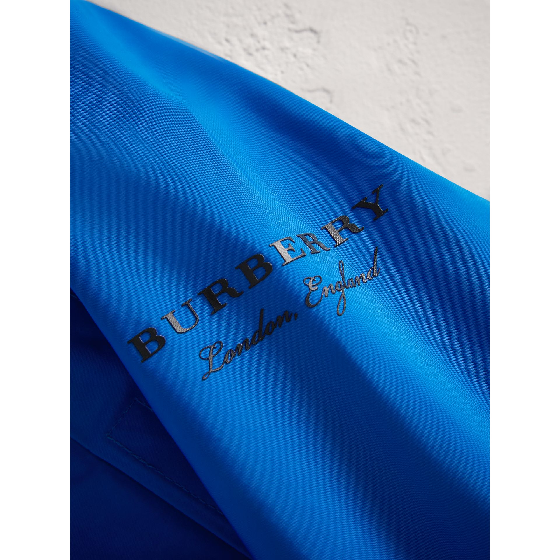 Shape Memory Taffeta Hooded Jacket in Azure Blue | Burberry - gallery image 1