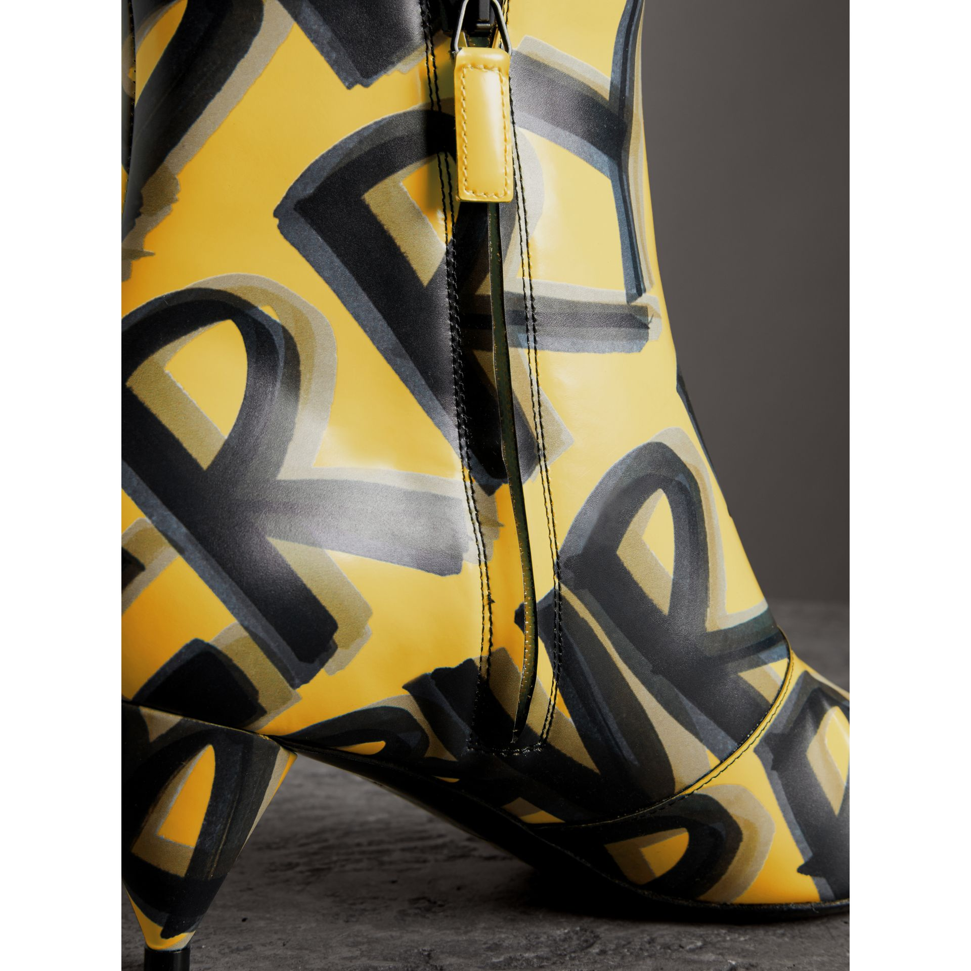 Graffiti Print Leather Ankle Boots in Vibrant Yellow - Women | Burberry Singapore - gallery image 1