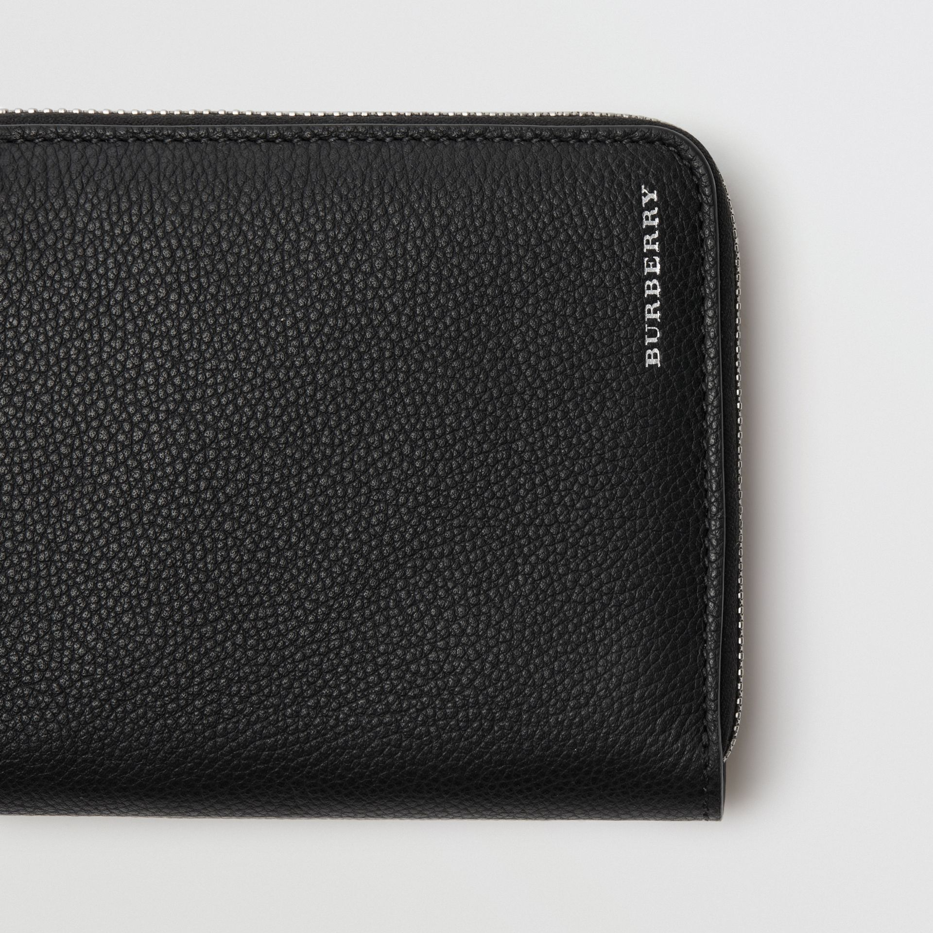 Grainy Leather Ziparound Wallet in Black - Men | Burberry United Kingdom - gallery image 1
