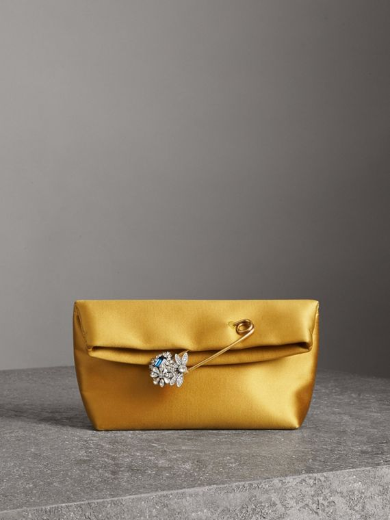 The Small Pin Clutch in Satin in Amber Yellow