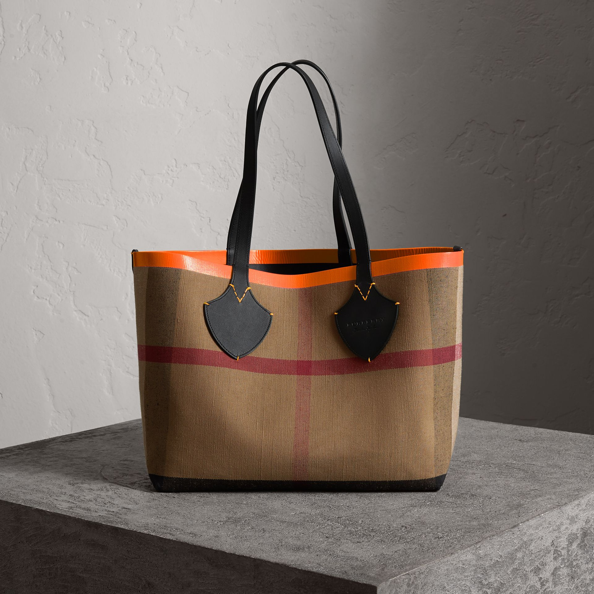 The Medium Giant Reversible Tote in Canvas and Leather in Black/neon Orange | Burberry United Kingdom - gallery image 0