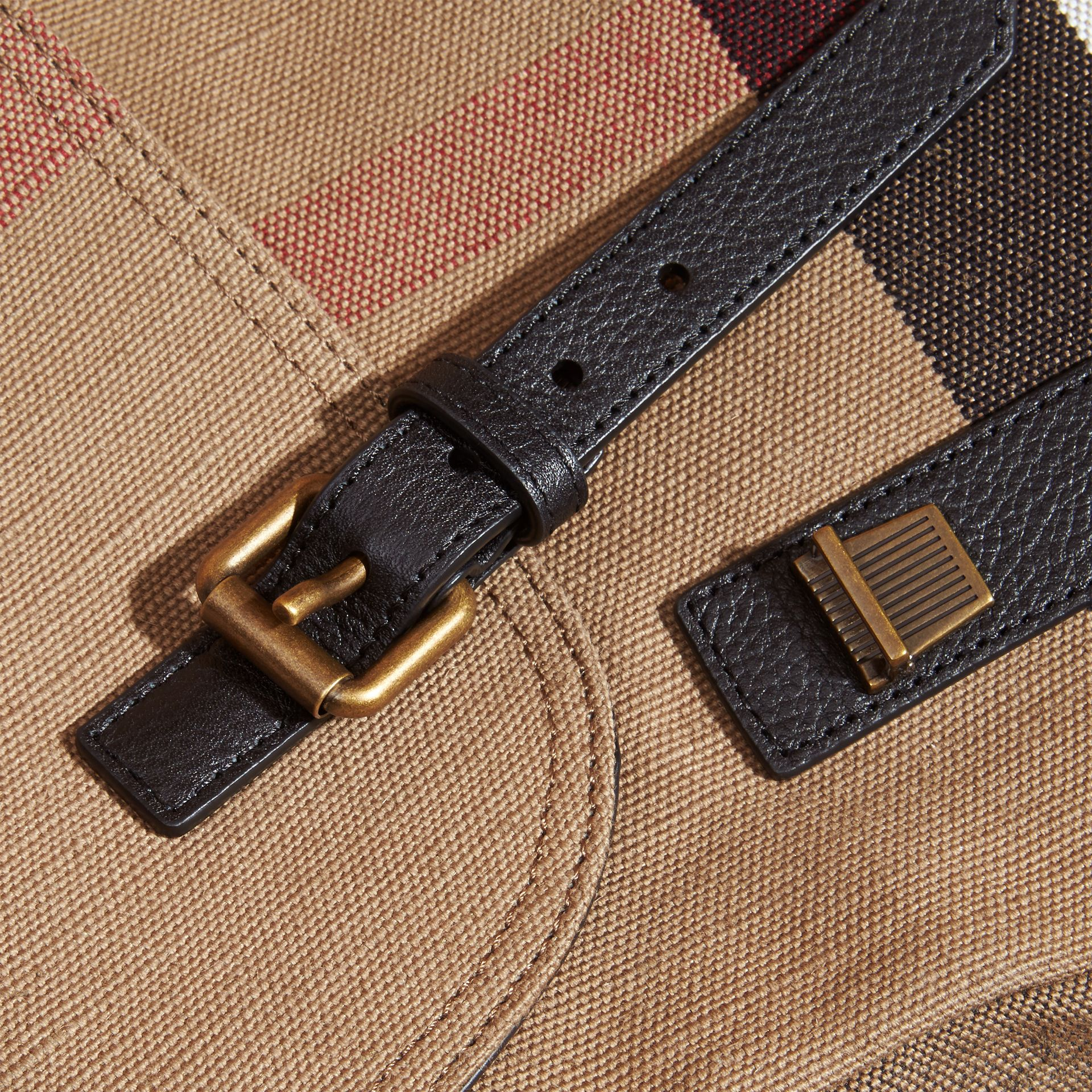 Small Canvas Check Messenger Bag in Black - Men | Burberry United Kingdom - gallery image 1