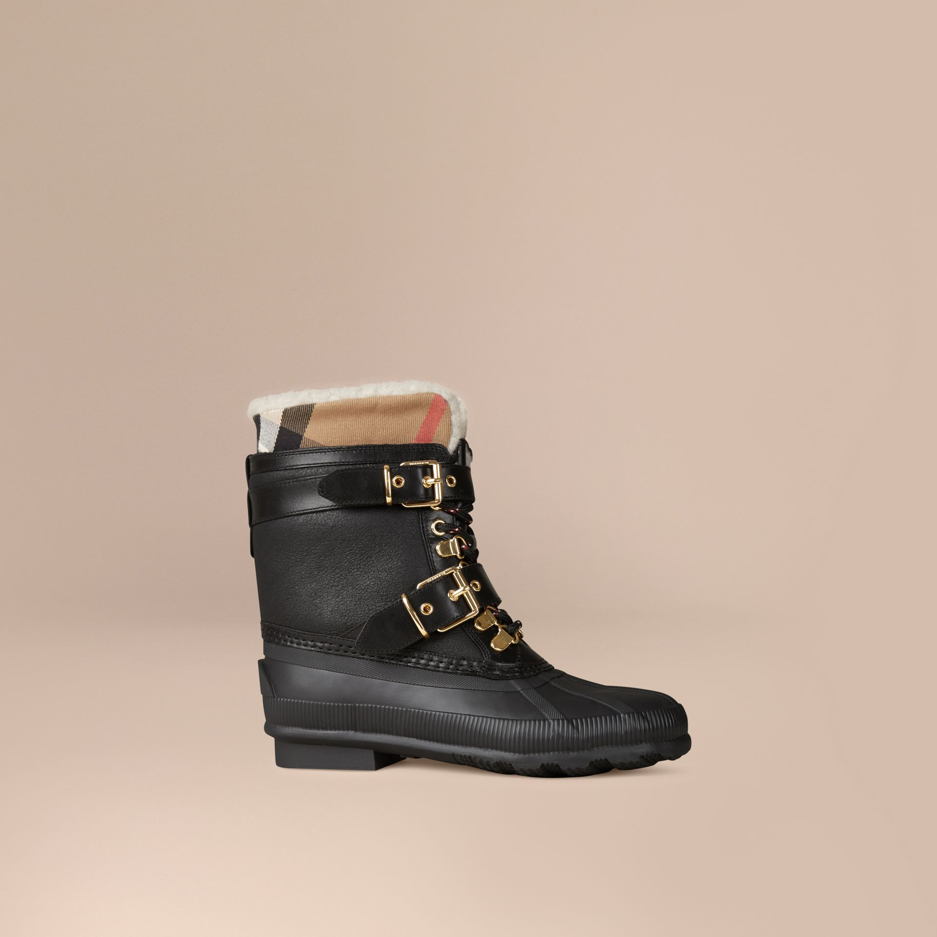 Sueded Shearling and Check Duck Boots in Black - Women | Burberry Singapore - gallery image 1