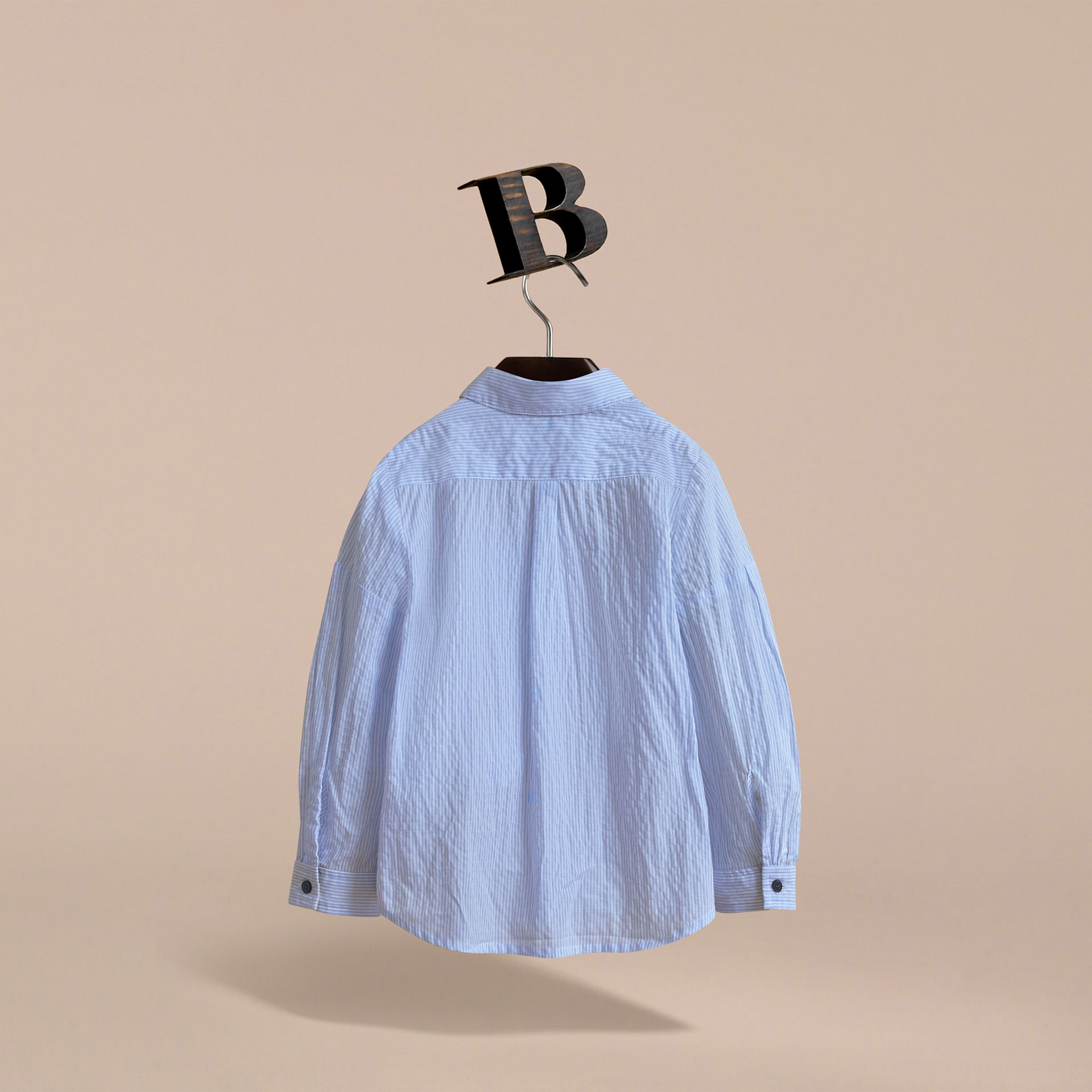 Bow Detail Striped Cotton Seersucker Shirt in Light Blue - Girl | Burberry - gallery image 4