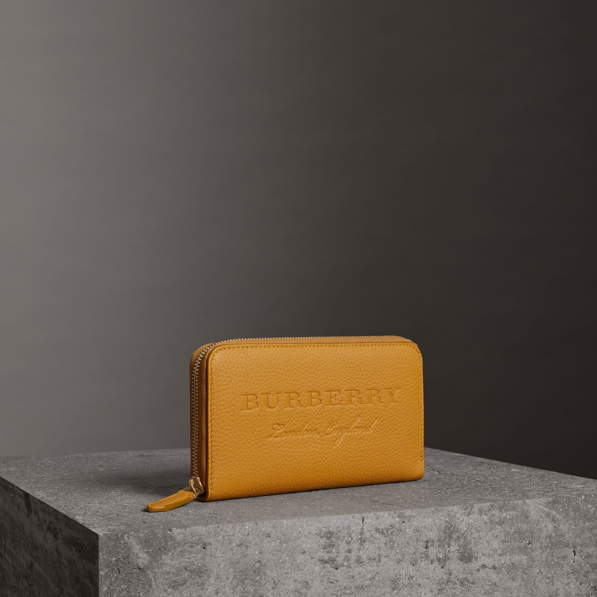 Embossed Leather Ziparound Wallet in Ochre Yellow - Women | Burberry - gallery image 0