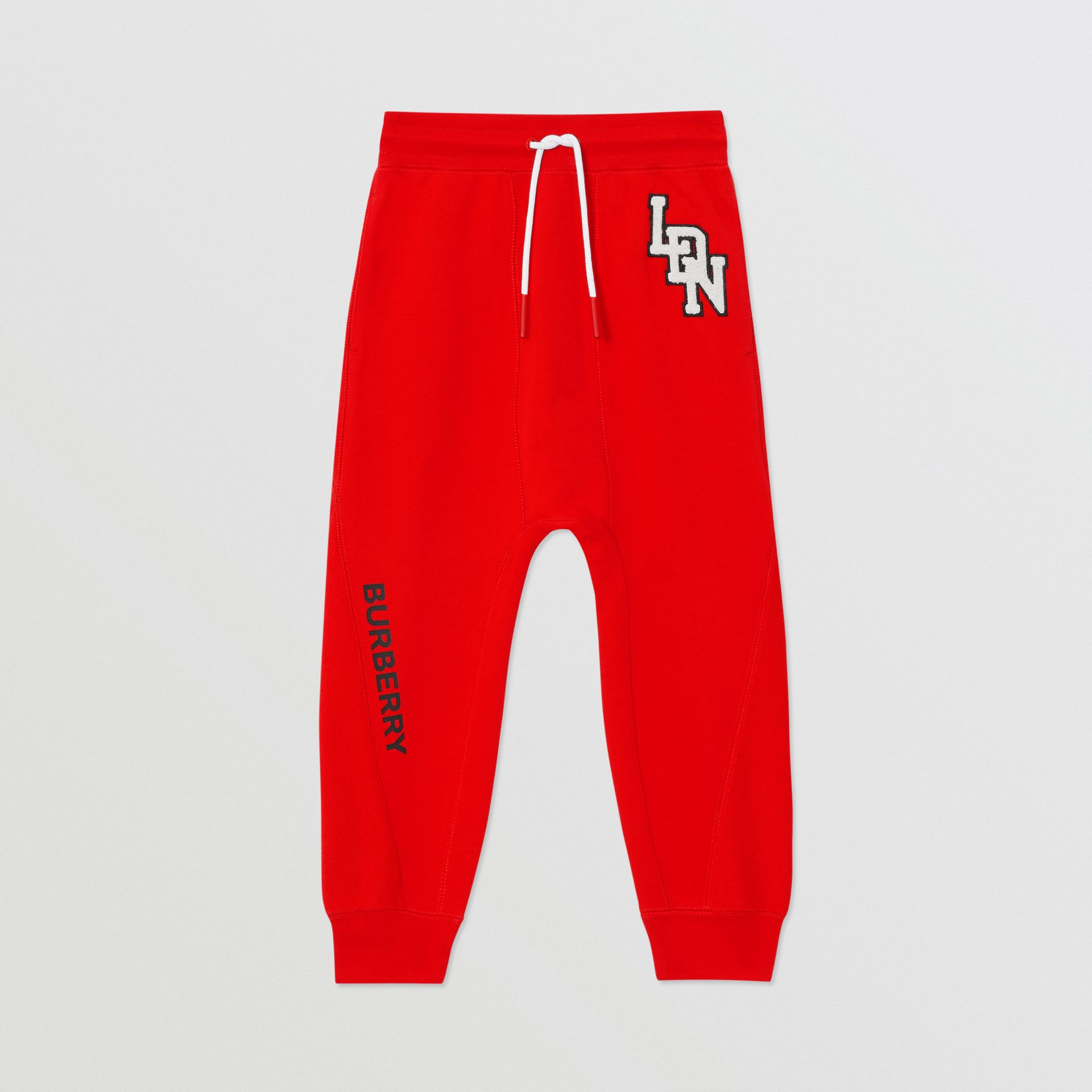 Logo Graphic Cotton Trackpants in Bright Red - Boy | Burberry United States - gallery image 0