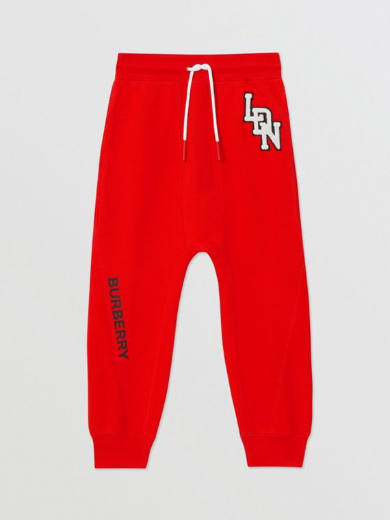Logo Graphic Cotton Trackpants in Bright Red