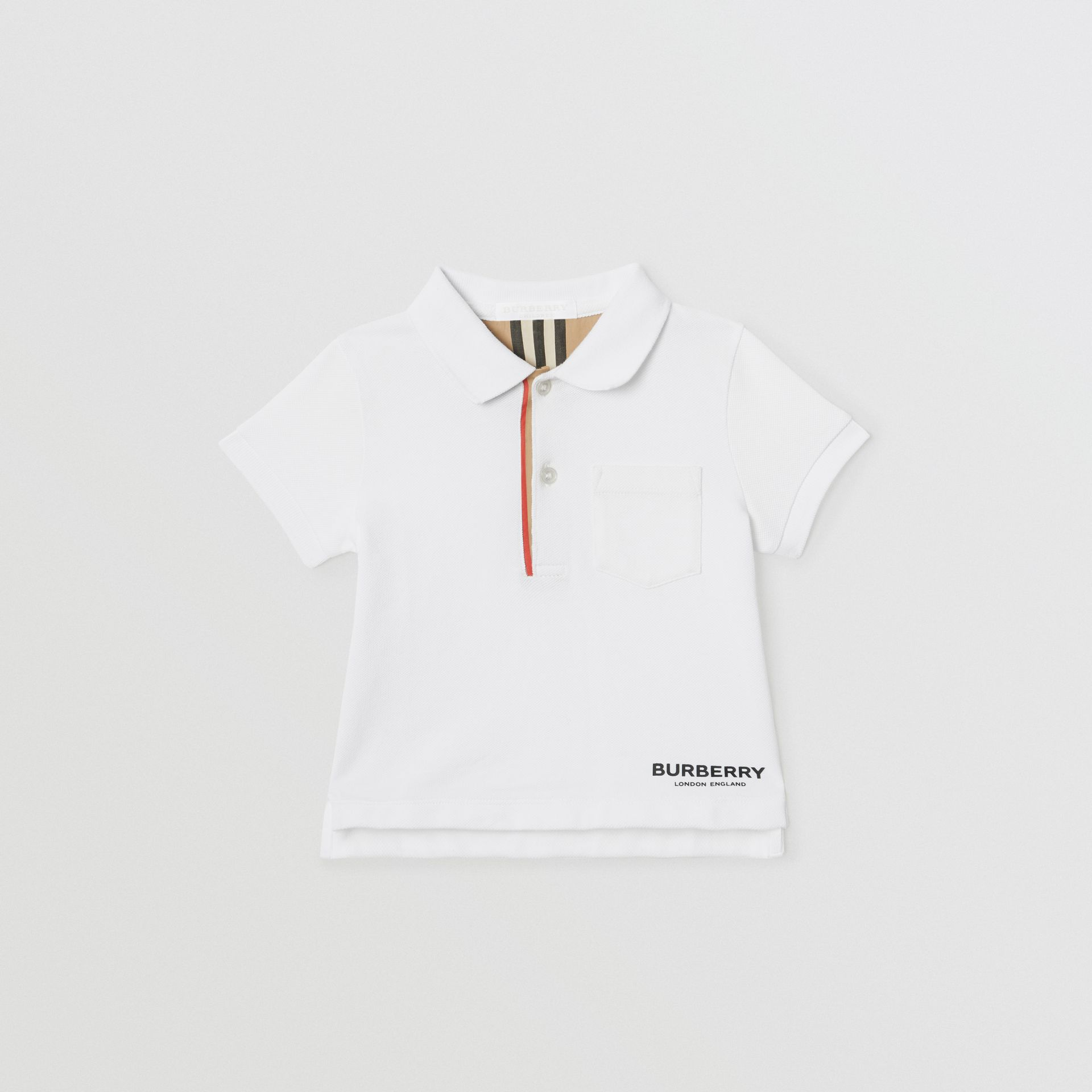 Icon Stripe Placket Cotton Piqué Polo Shirt in White - Children | Burberry United Kingdom - gallery image 0