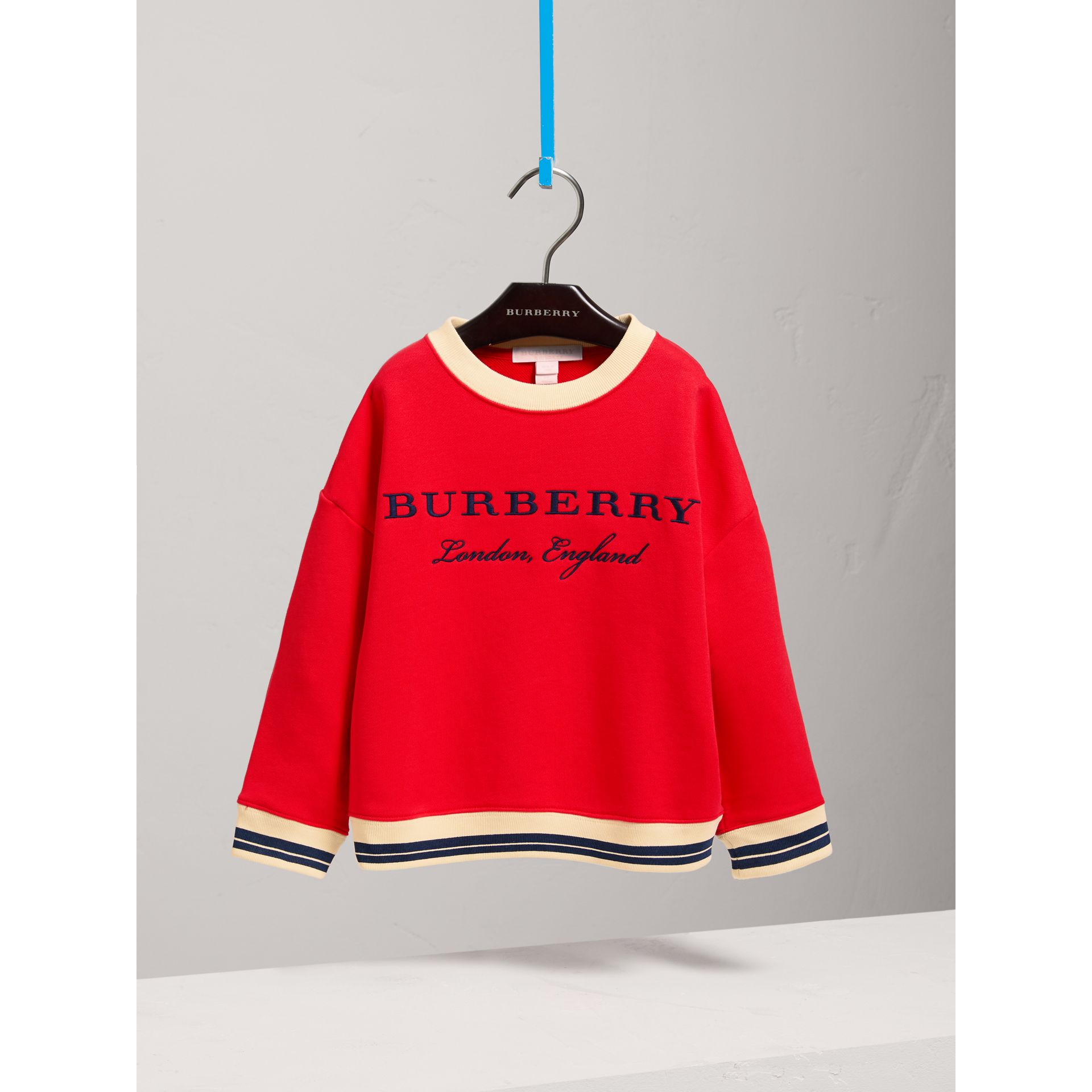 Striped Hem Embroidered Cotton Jersey Sweatshirt in Bright Orange Red - Girl | Burberry - gallery image 0