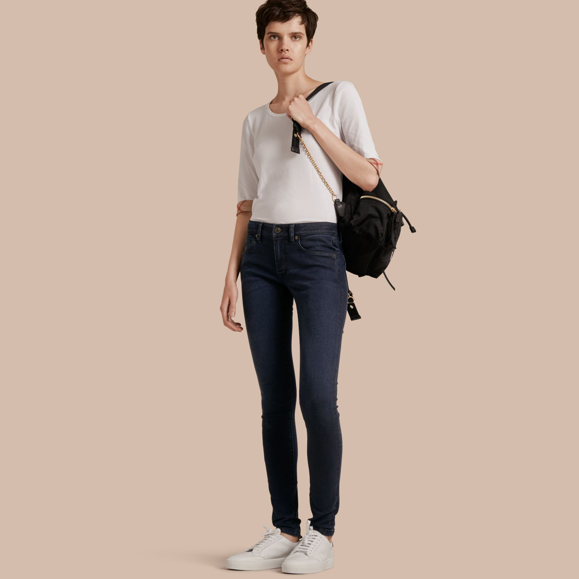 Skinny Fit Power-Stretch Jeans in Dark Indigo - Women | Burberry - gallery image 1