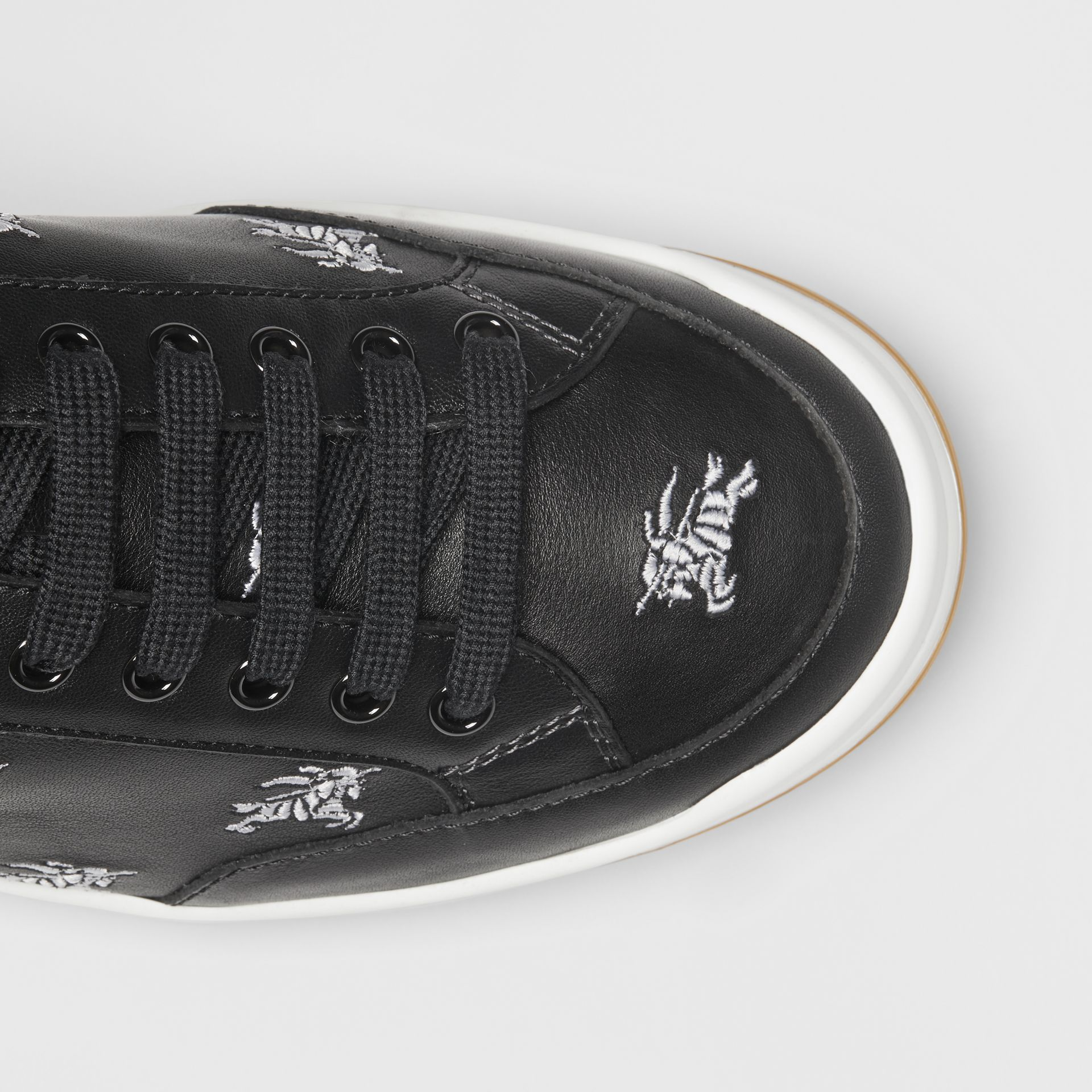 Logo Print Leather Sneakers in Black - Men | Burberry Canada - gallery image 1