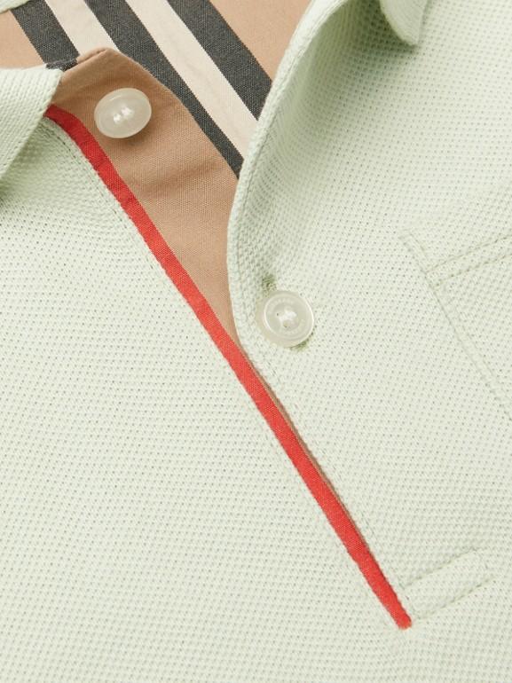 Polo in cotone piqué con iconico motivo a righe sulla paramontura (Menta Pallido) - Bambino | Burberry - cell image 1