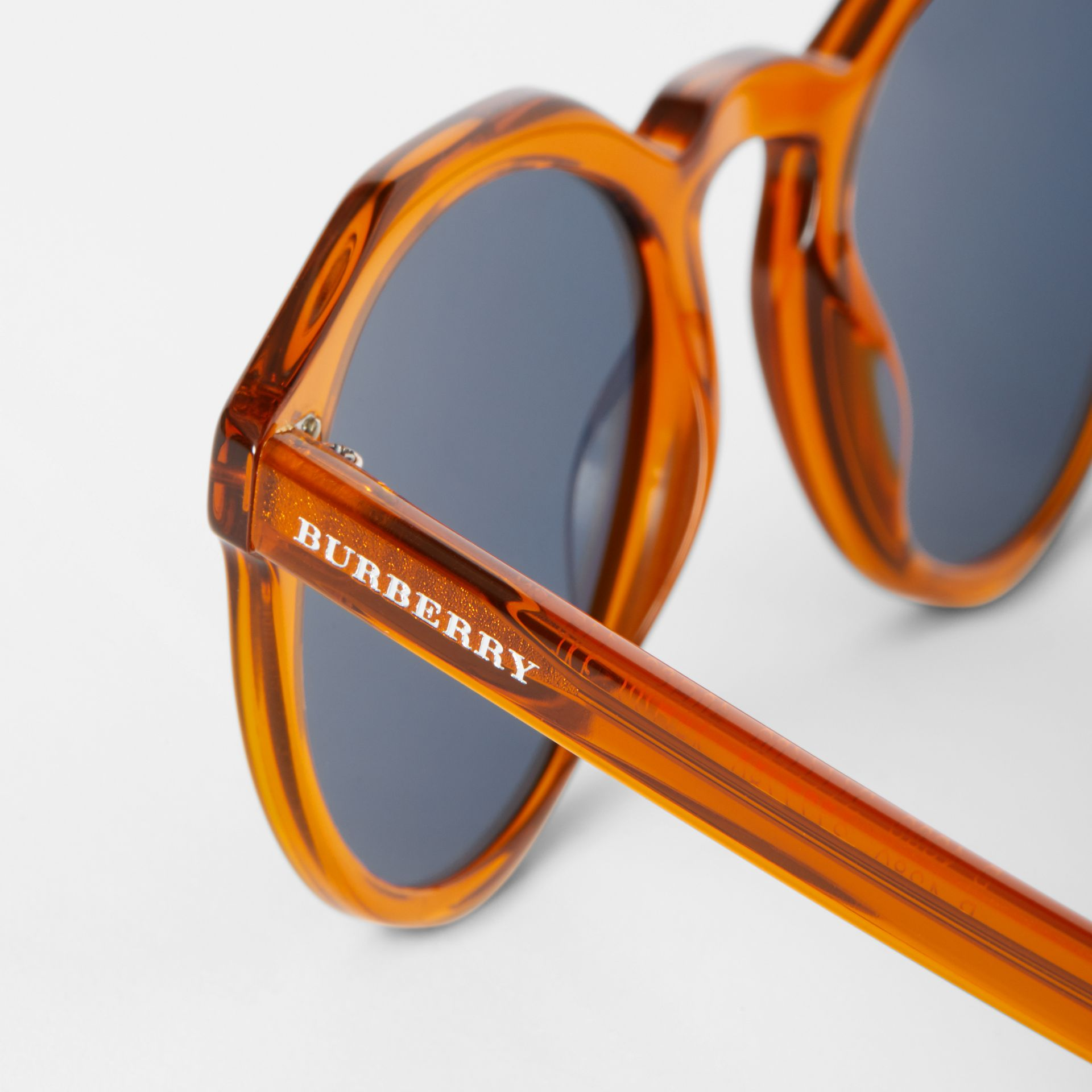 Keyhole Round Frame Sunglasses in Orange - Men | Burberry - gallery image 1