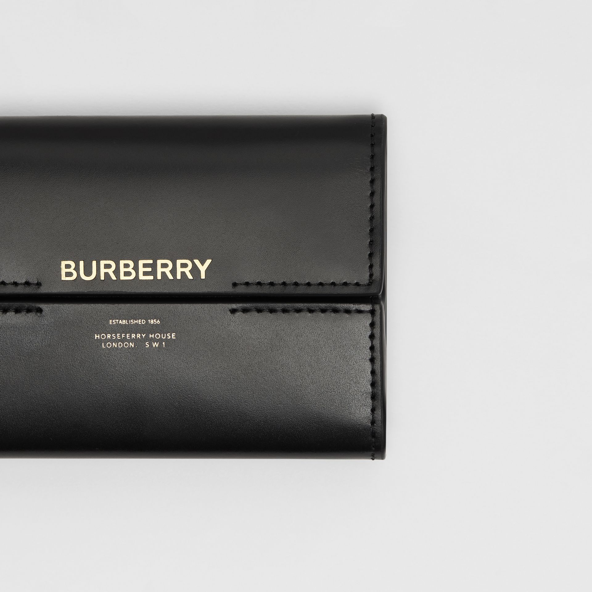 Horseferry Print Leather Folding Wallet in Black | Burberry - gallery image 1