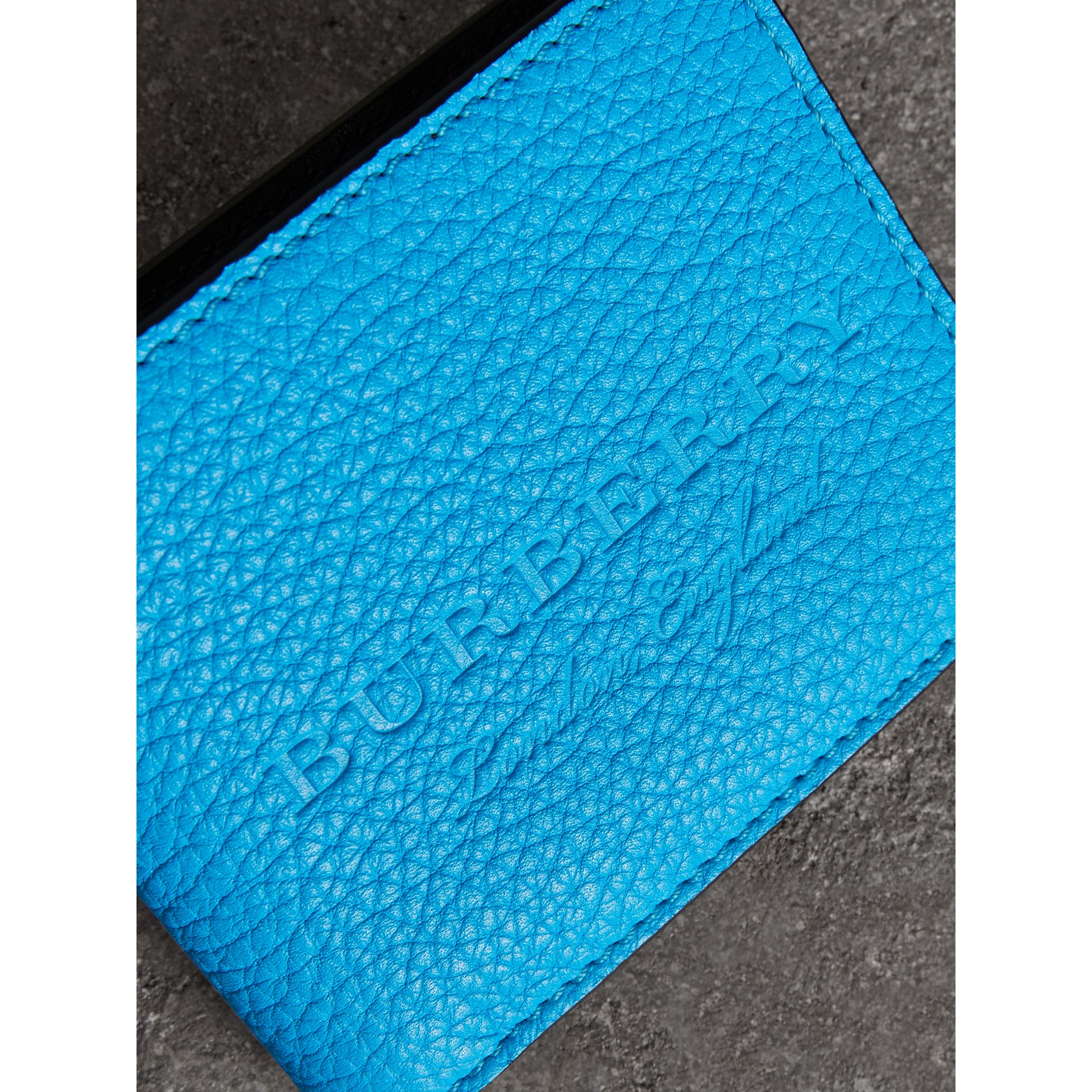 Embossed Leather Bifold Wallet in Neon Blue - Men | Burberry United States - gallery image 1