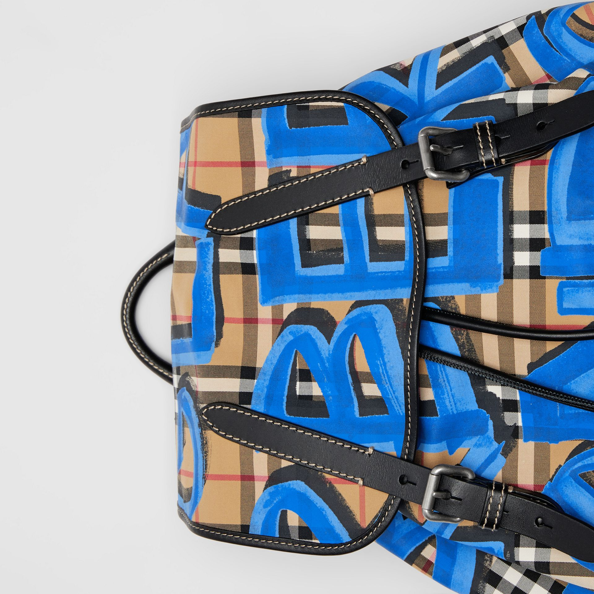 The Large Rucksack in Graffiti Print Vintage Check in Canvas Blue/antique Yellow | Burberry Hong Kong - gallery image 1
