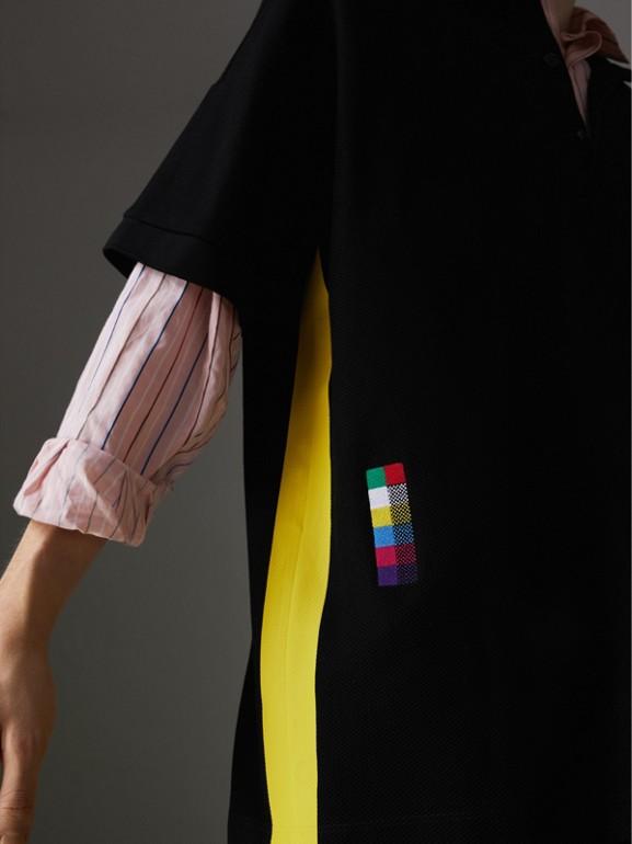 Sport Stripe Oversized Polo Shirt in Black - Men | Burberry United Kingdom - cell image 1