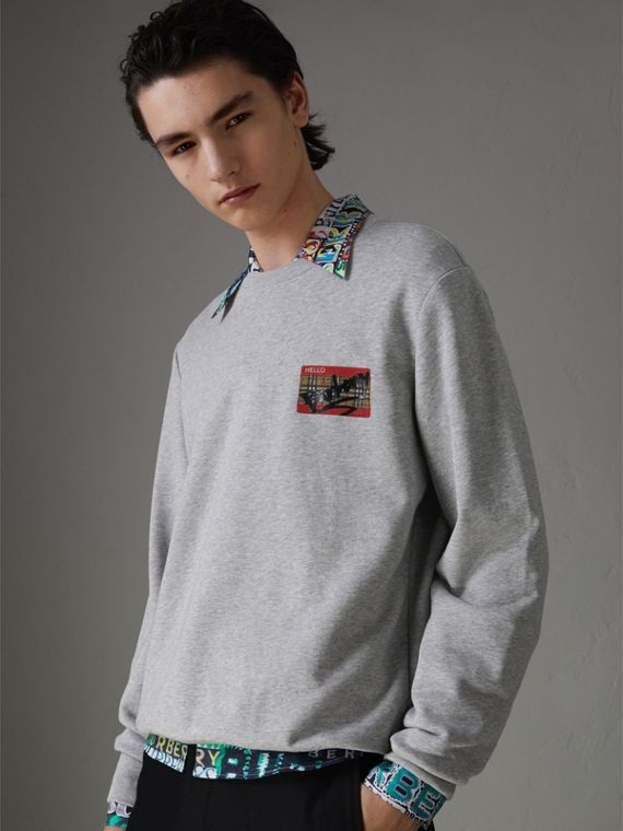 Graffitied Ticket Print Sweatshirt in Pale Grey Melange