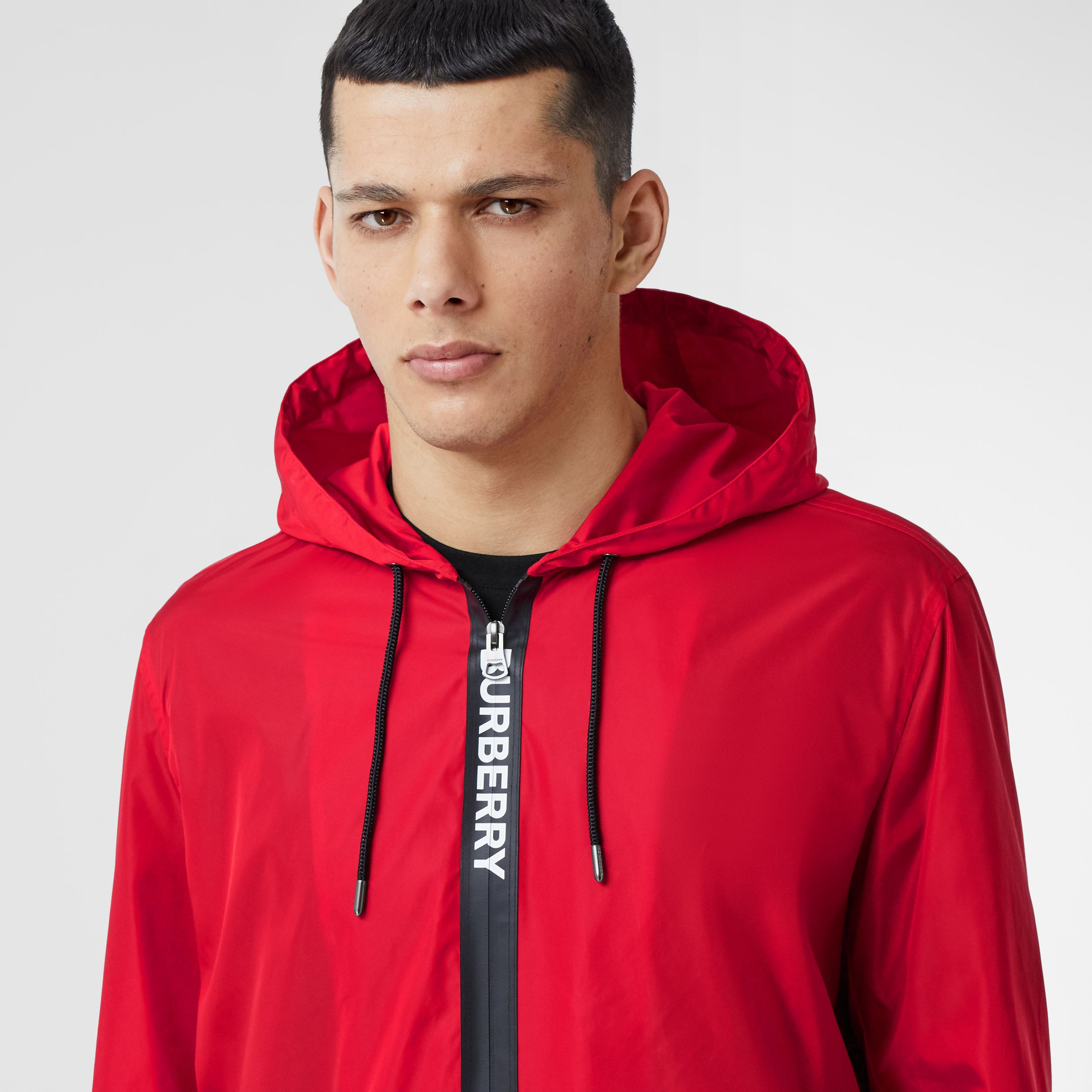 Logo Tape ECONYL® Hooded Jacket in Bright Red - Men | Burberry - 2