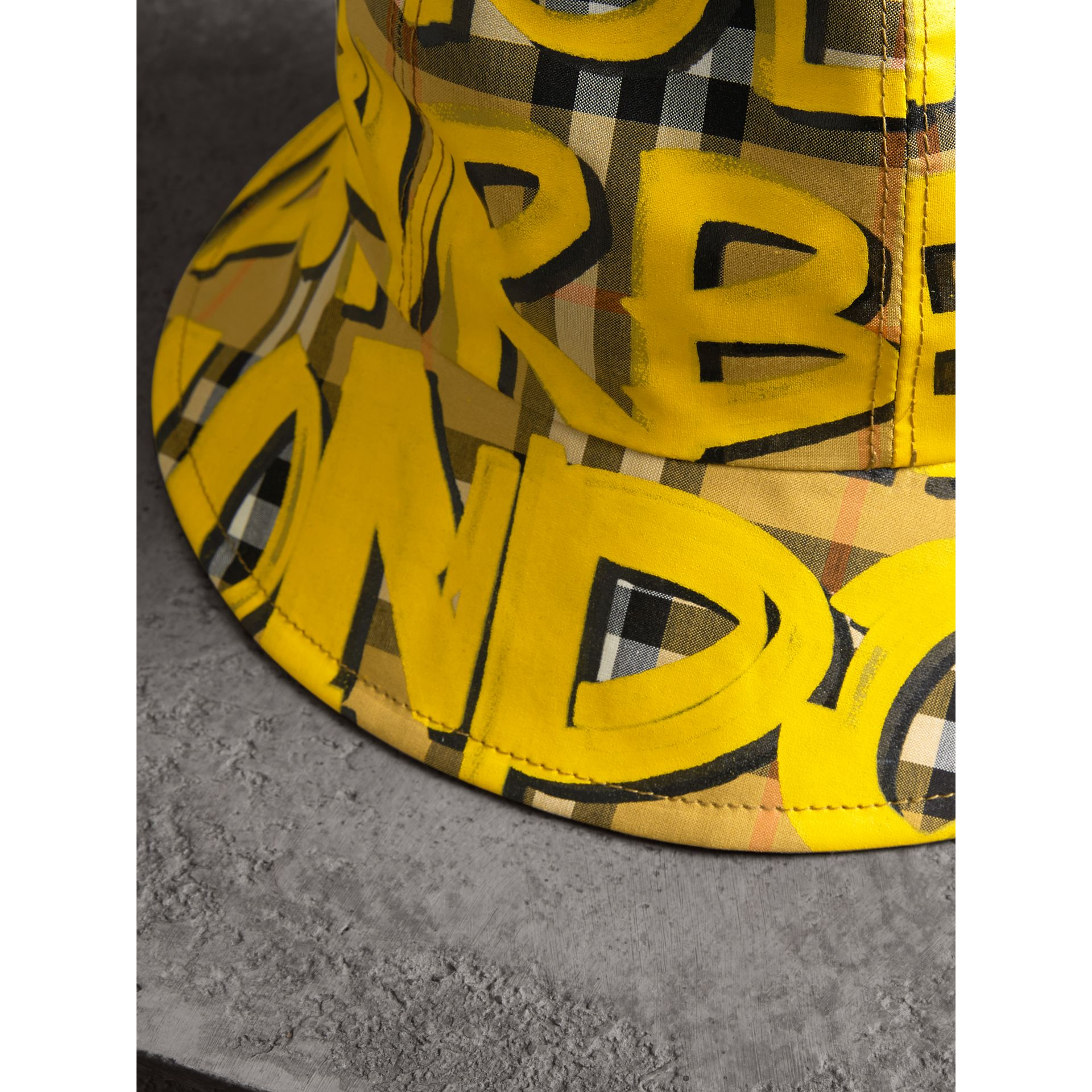 Graffiti Print Vintage Check Bucket Hat in Bright Yellow/antique Yellow | Burberry United Kingdom - gallery image 1