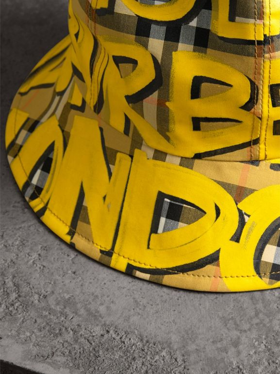 Graffiti Print Vintage Check Bucket Hat in Bright Yellow/antique Yellow | Burberry Canada - cell image 1