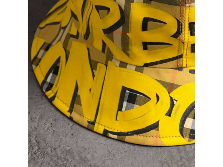 Graffiti Print Vintage Check Bucket Hat in Bright Yellow/antique Yellow | Burberry - cell image 1