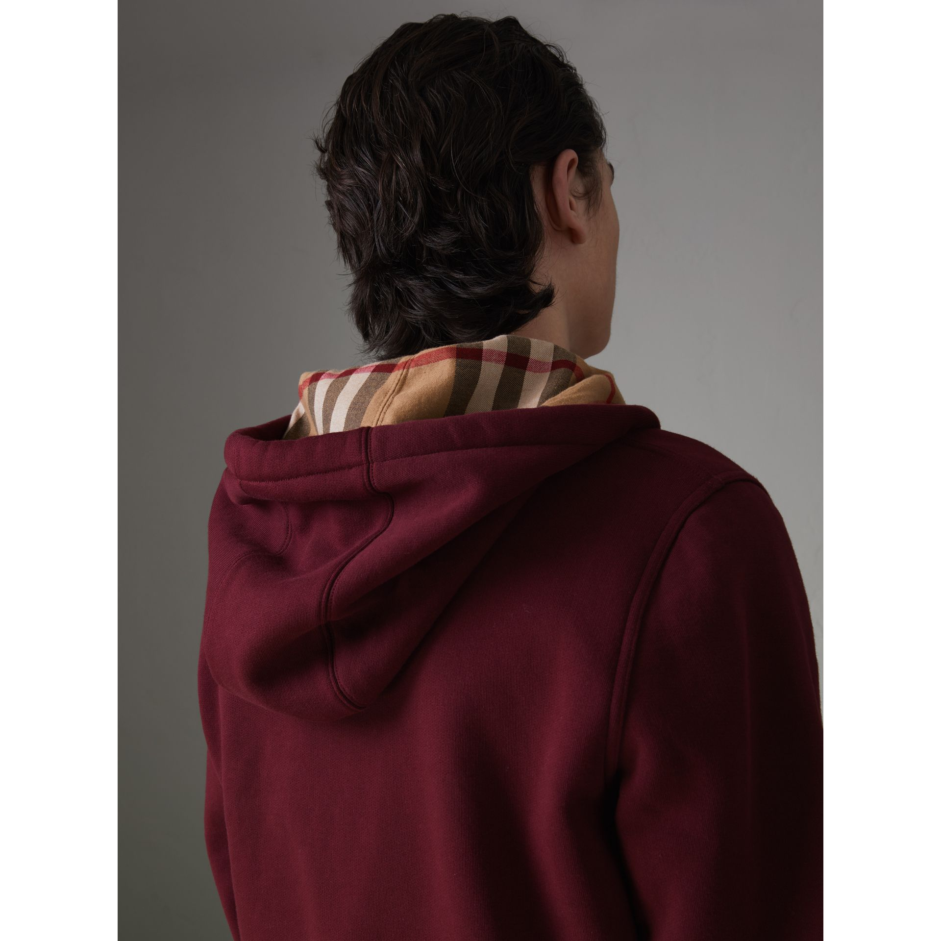 Check Detail Jersey Hooded Top in Dark Crimson - Men | Burberry United Kingdom - gallery image 1