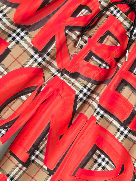 Graffiti Print Vintage Check Drawcord Swim Shorts in Bright Military Red - Men | Burberry United Kingdom - cell image 1