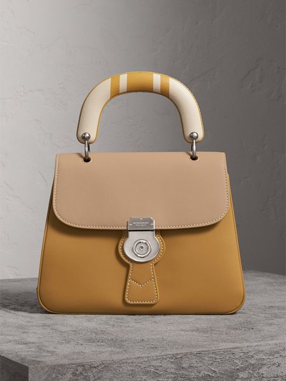 The Medium DK88 Top Handle Bag with Geometric Print in Ochre Yellow/honey