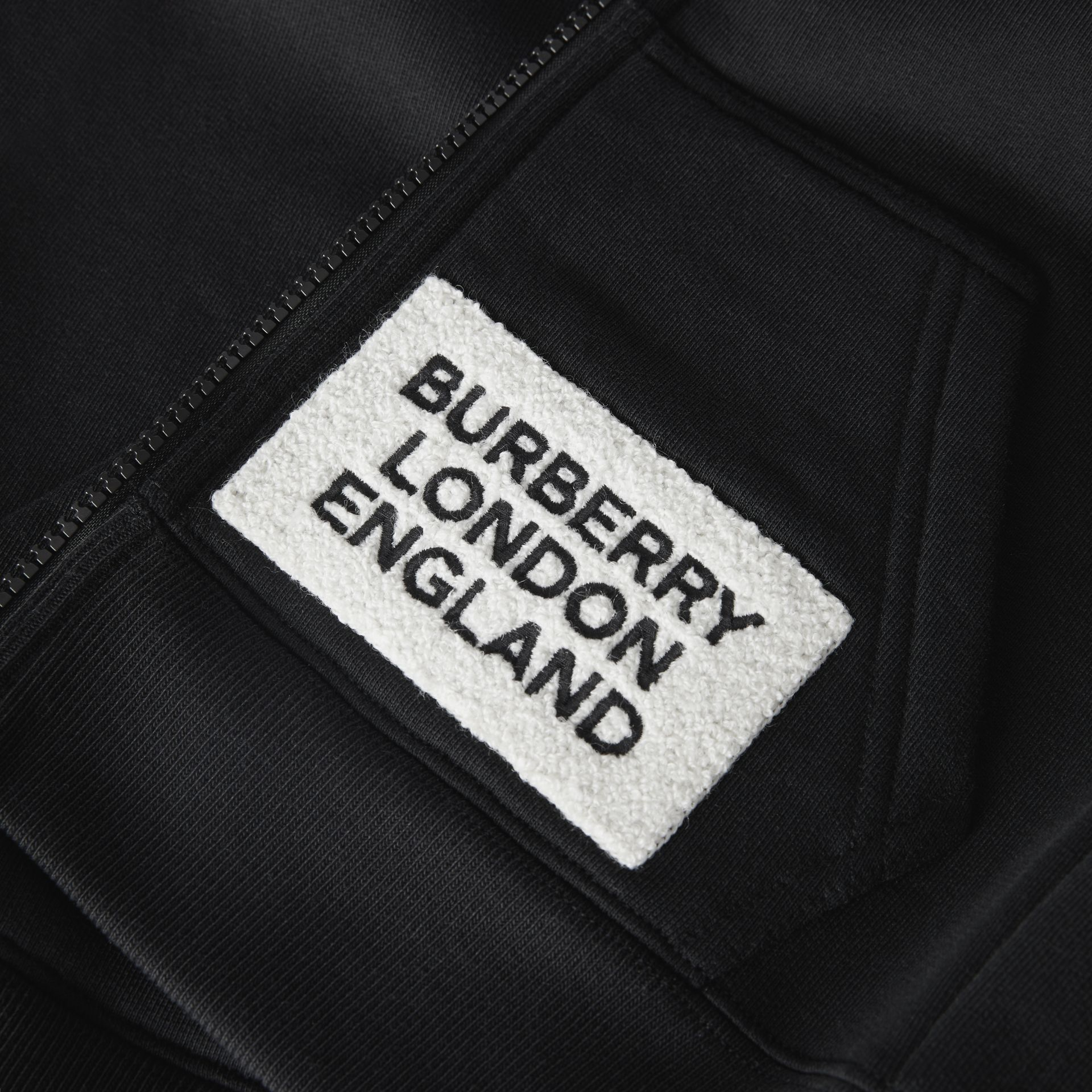 Logo Detail Jersey Hooded Top in Black | Burberry - gallery image 1