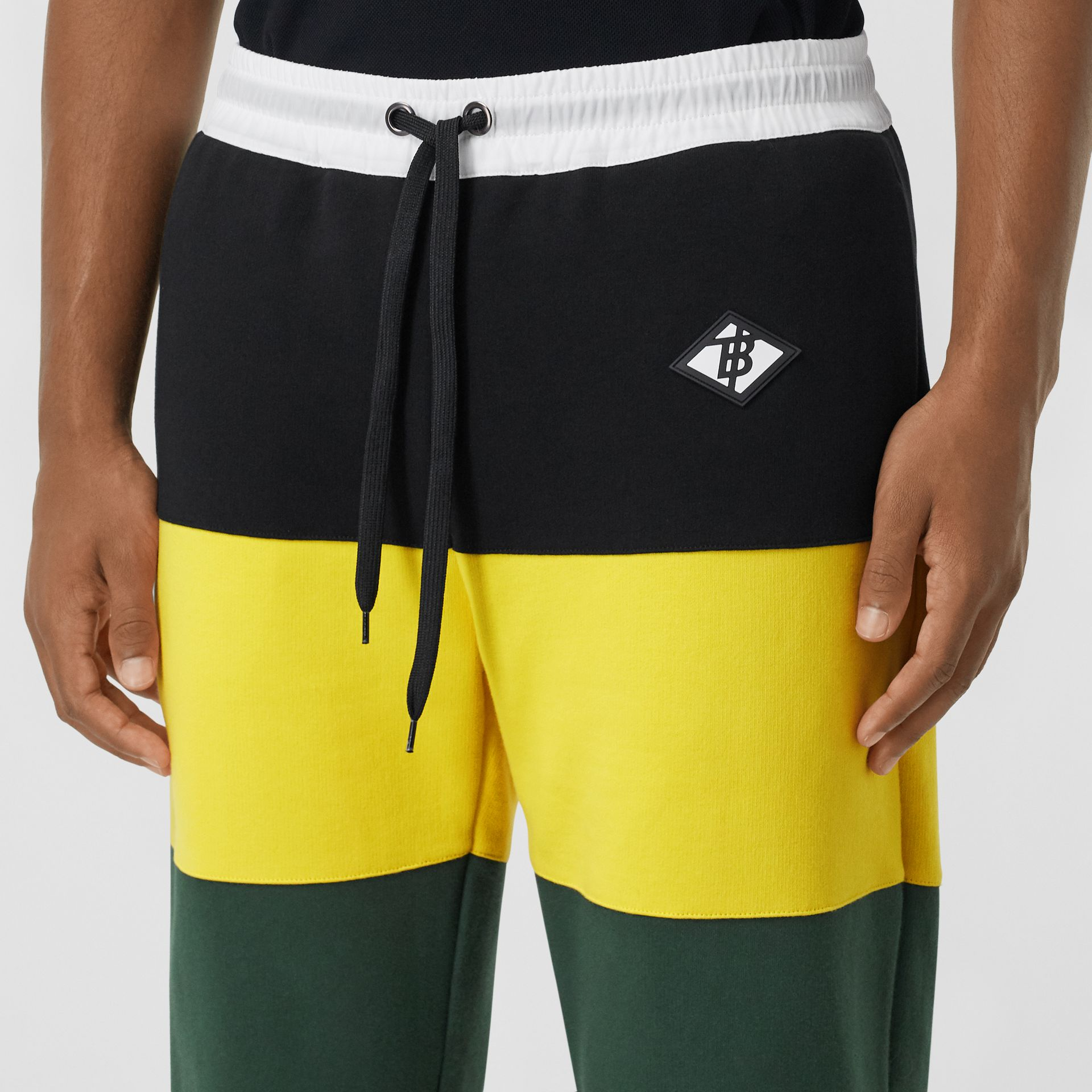 Logo Graphic Colour Block Cotton Trackpants in Canary Yellow - Men | Burberry Hong Kong S.A.R - gallery image 1