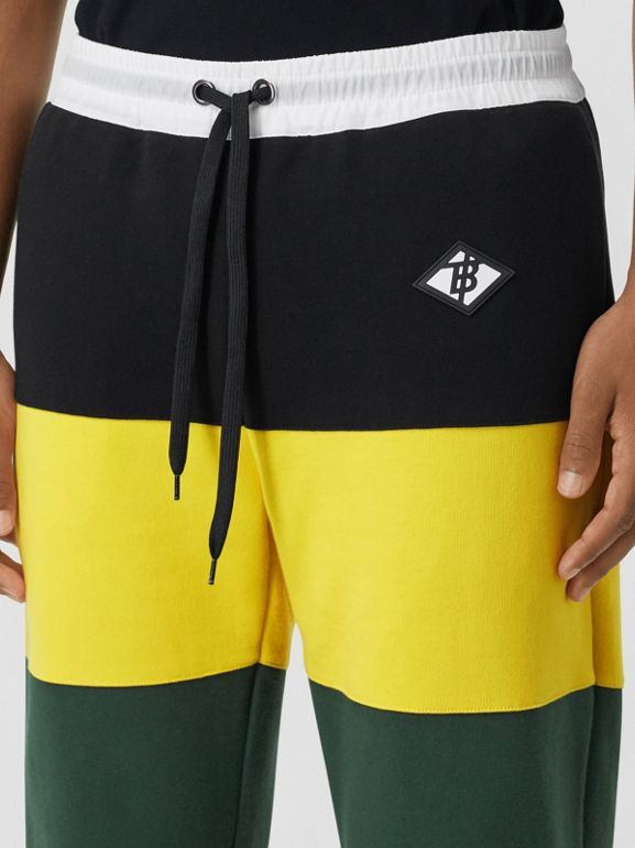 Logo Graphic Colour Block Cotton Trackpants in Canary Yellow - Men | Burberry Hong Kong S.A.R - cell image 1