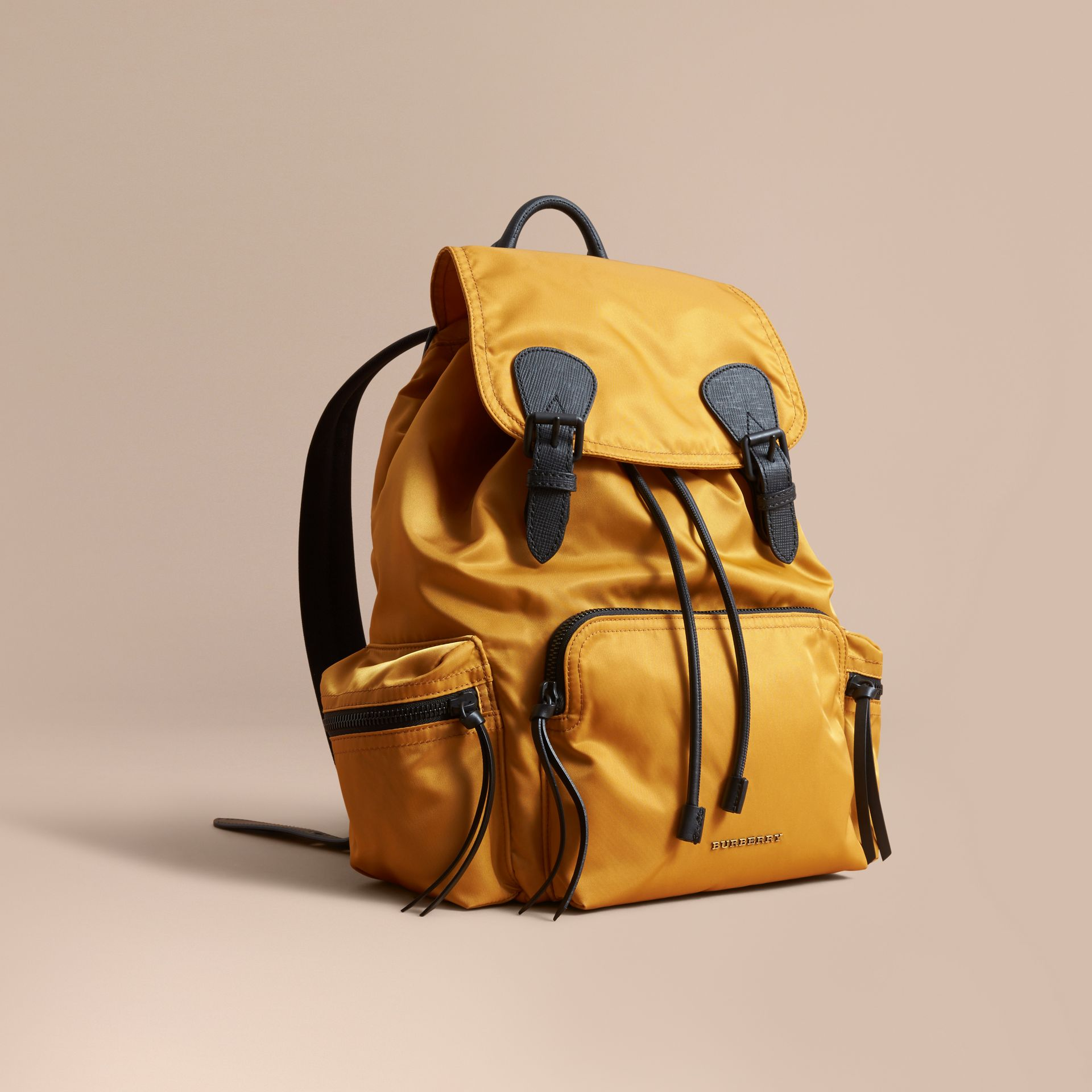 The Large Rucksack in Technical Nylon and Leather in Ochre Yellow - gallery image 1