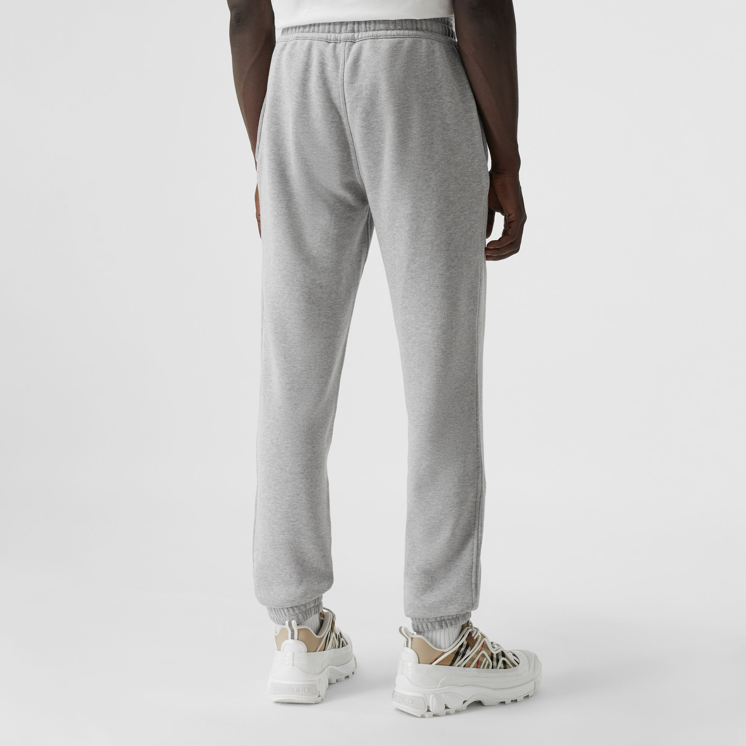 Logo Graphic Appliqué Cotton Jogging Pants in Pale Grey Melange - Men | Burberry - 3