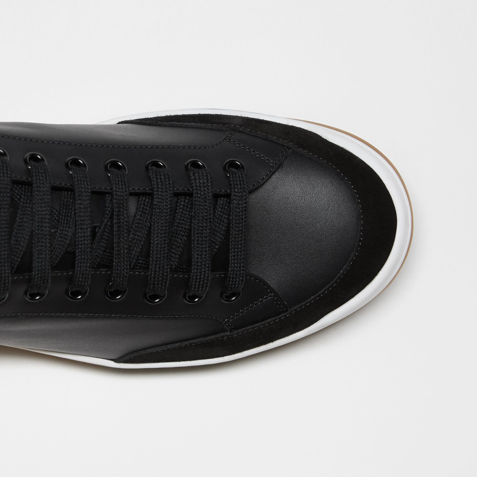 Perforated Logo Leather Tennis Sneakers in Black/optic White - Men | Burberry - gallery image 1
